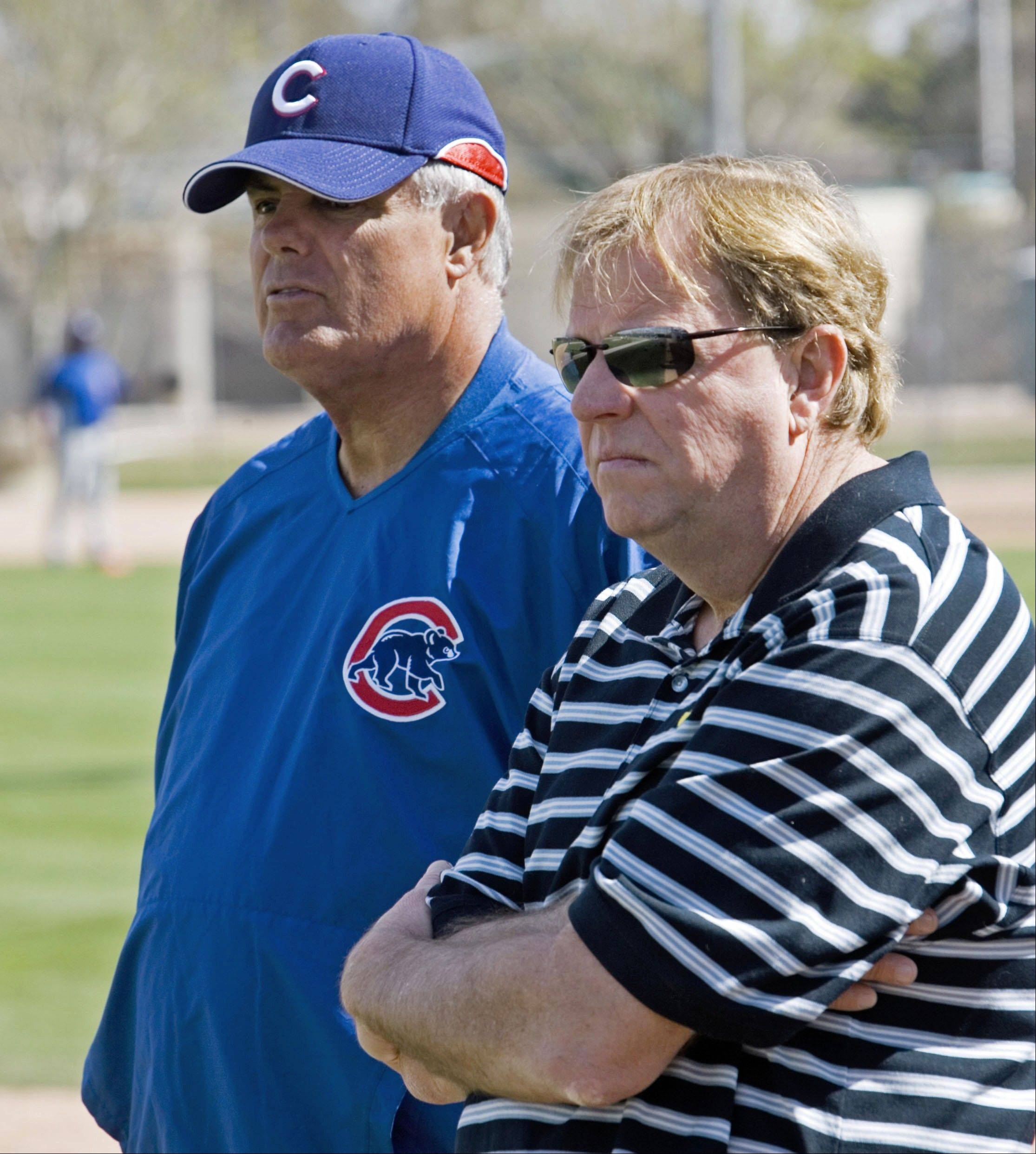 Chicago Cubs manager Lou Piniella, left, and general manager Jim Hendry watch batting practice during a spring training baseball workout at the team's practice facility in this Feb. 25, 2007 file photo, in Mesa, Ariz.