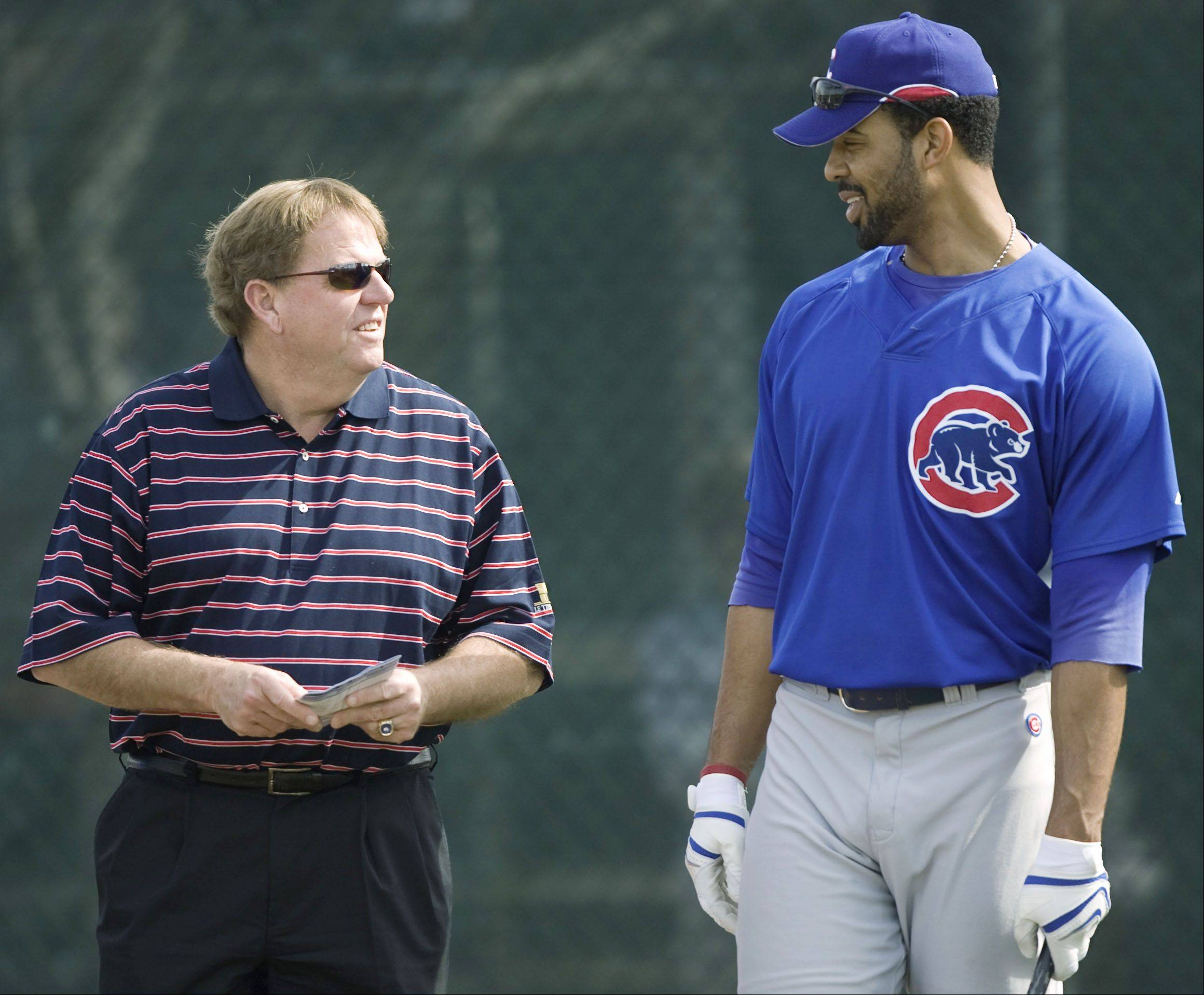 Associated PressChicago Cubs' Derrek Lee, right, talks to general manager Jim Hendry at baseball spring training on Tuesday, Feb. 19, 2008, in Mesa, Ariz.