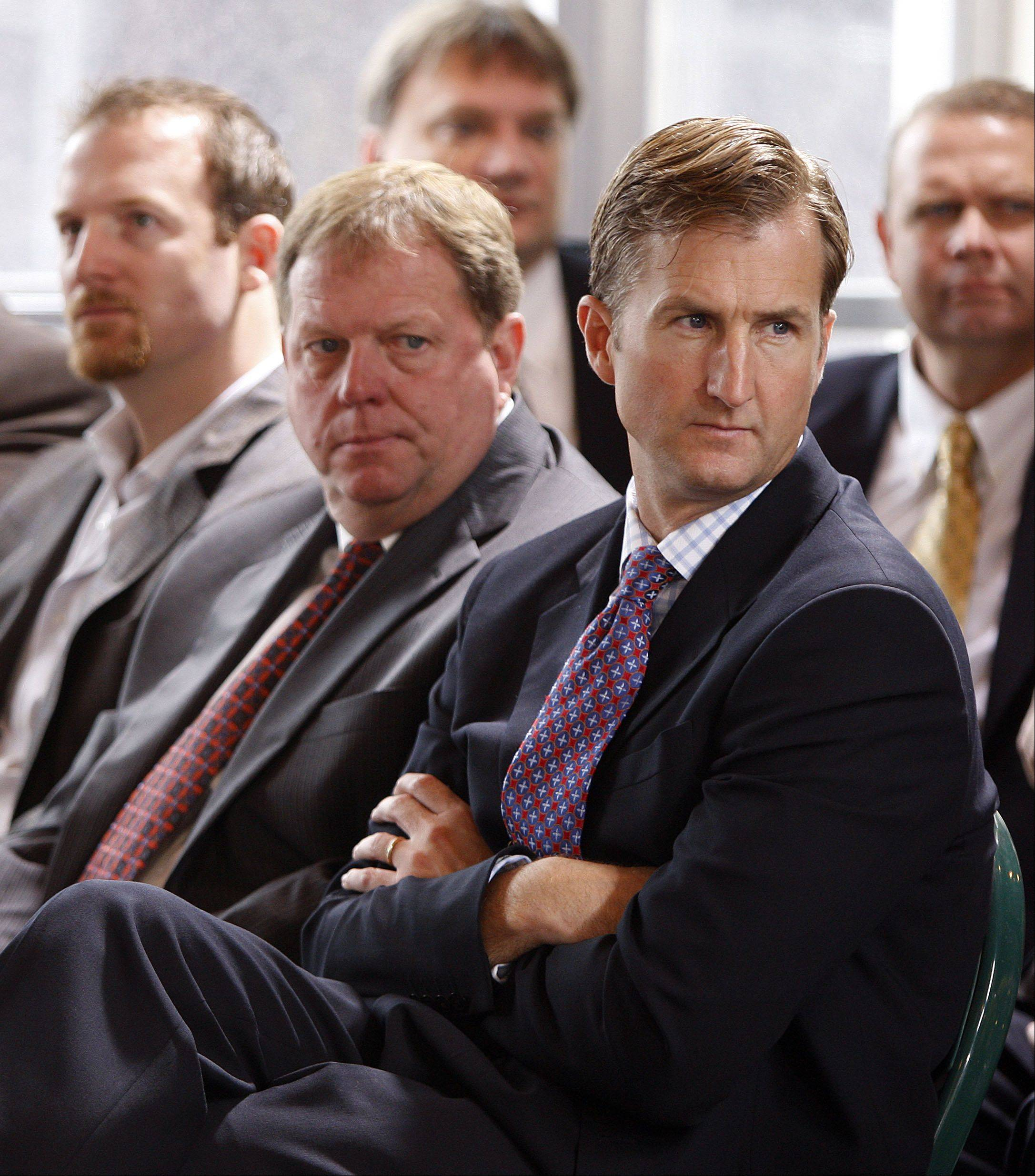 Associated PressChicago Cubs player Ryan Dempster, left, general manager Jim Hendry, center, and chairman Crane Kenney listen to new team owner Tom Ricketts during a news conference at Wrigley Field on Friday, Oct. 30, 2009, in Chicago.