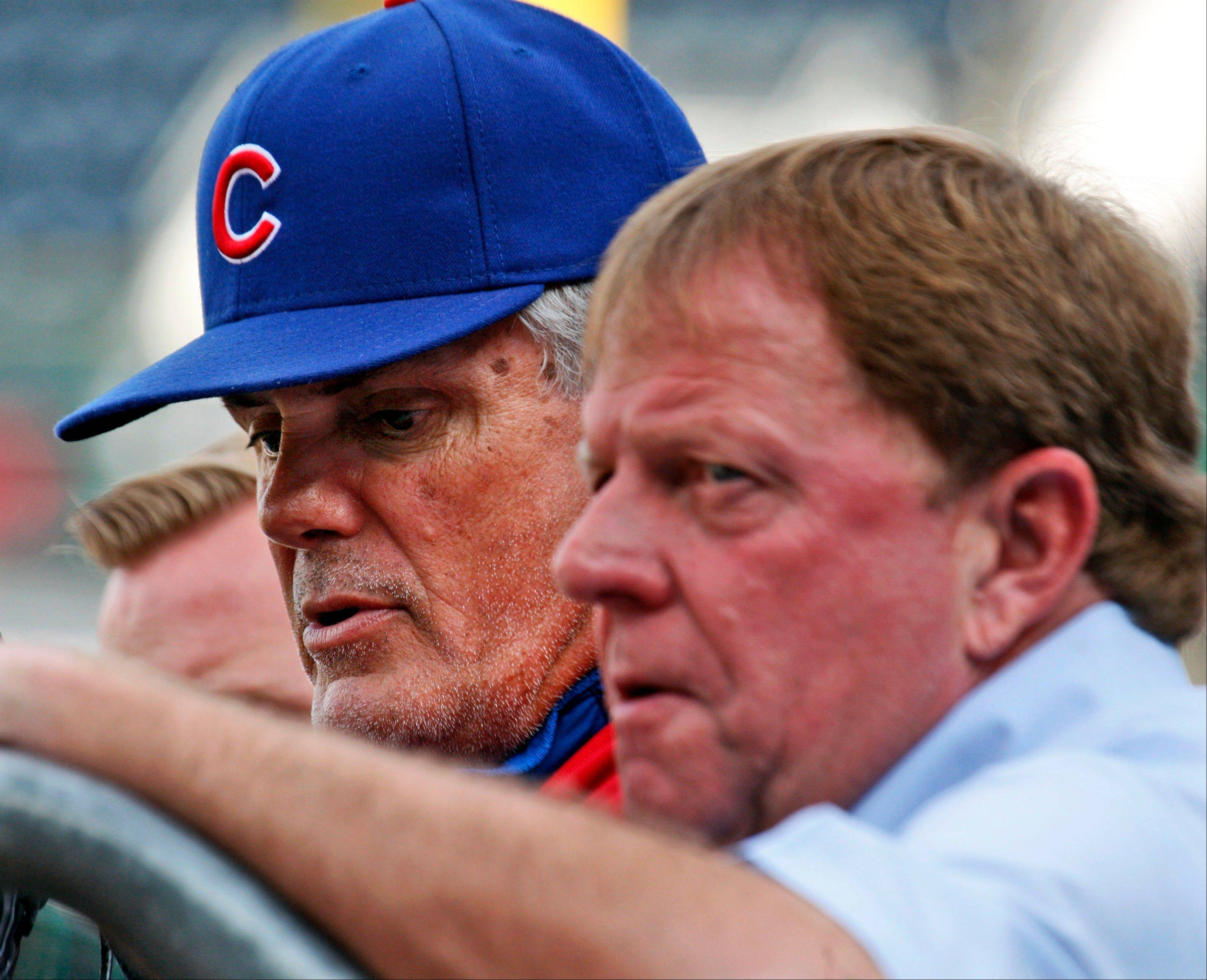 Chicago Cubs manager Lou Piniella, left, talks with Cubs general manager Jim Hendry before a baseball game against the Pittsburgh Pirates in Pittsburgh Tuesday, June 1, 2010.