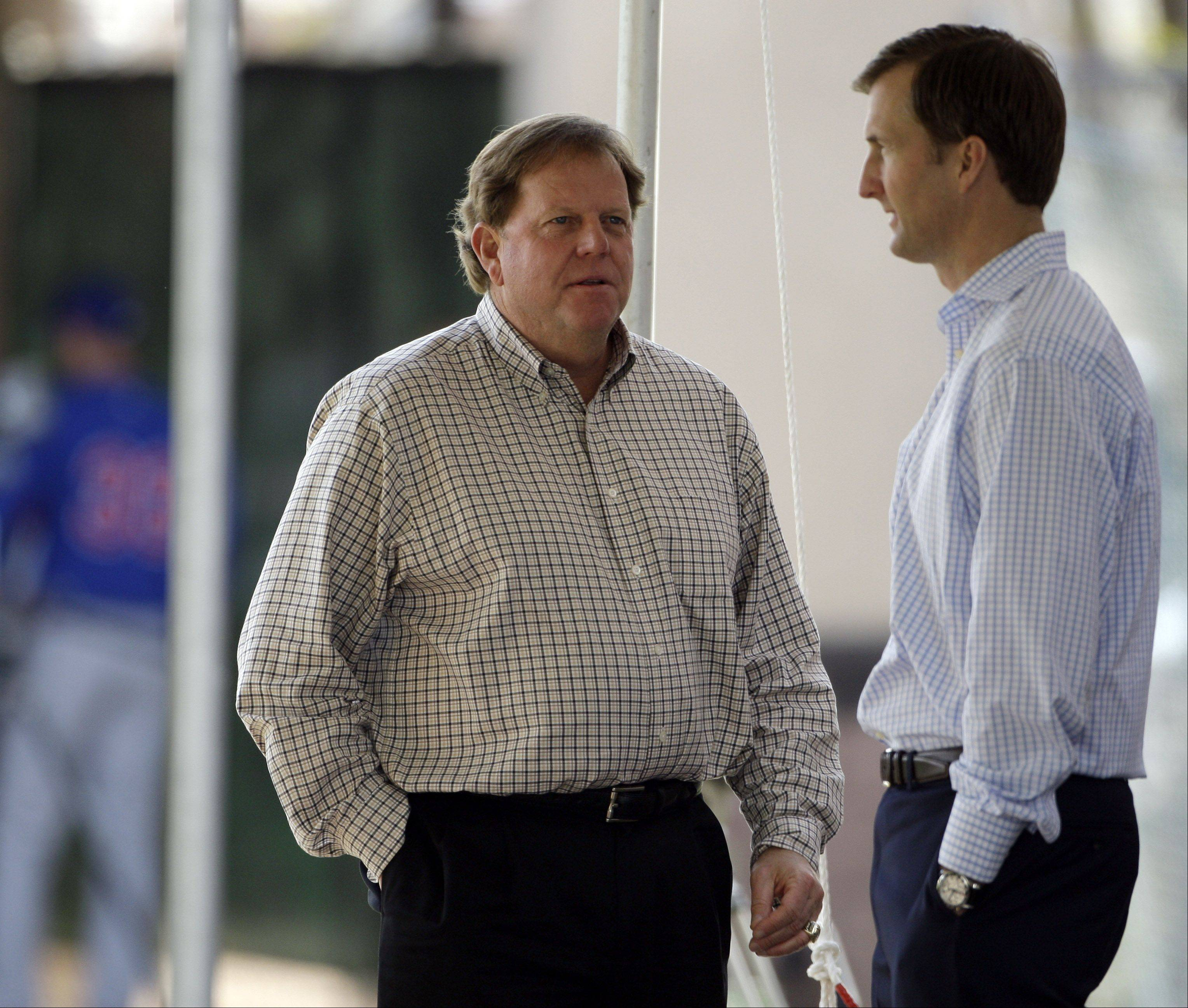 Chairman of the Chicago Cubs Crane Kenney, right, talks to general manager Jim Hendry, left, during spring training baseball Tuesday, Feb. 17, 2009, in Mesa, Ariz.