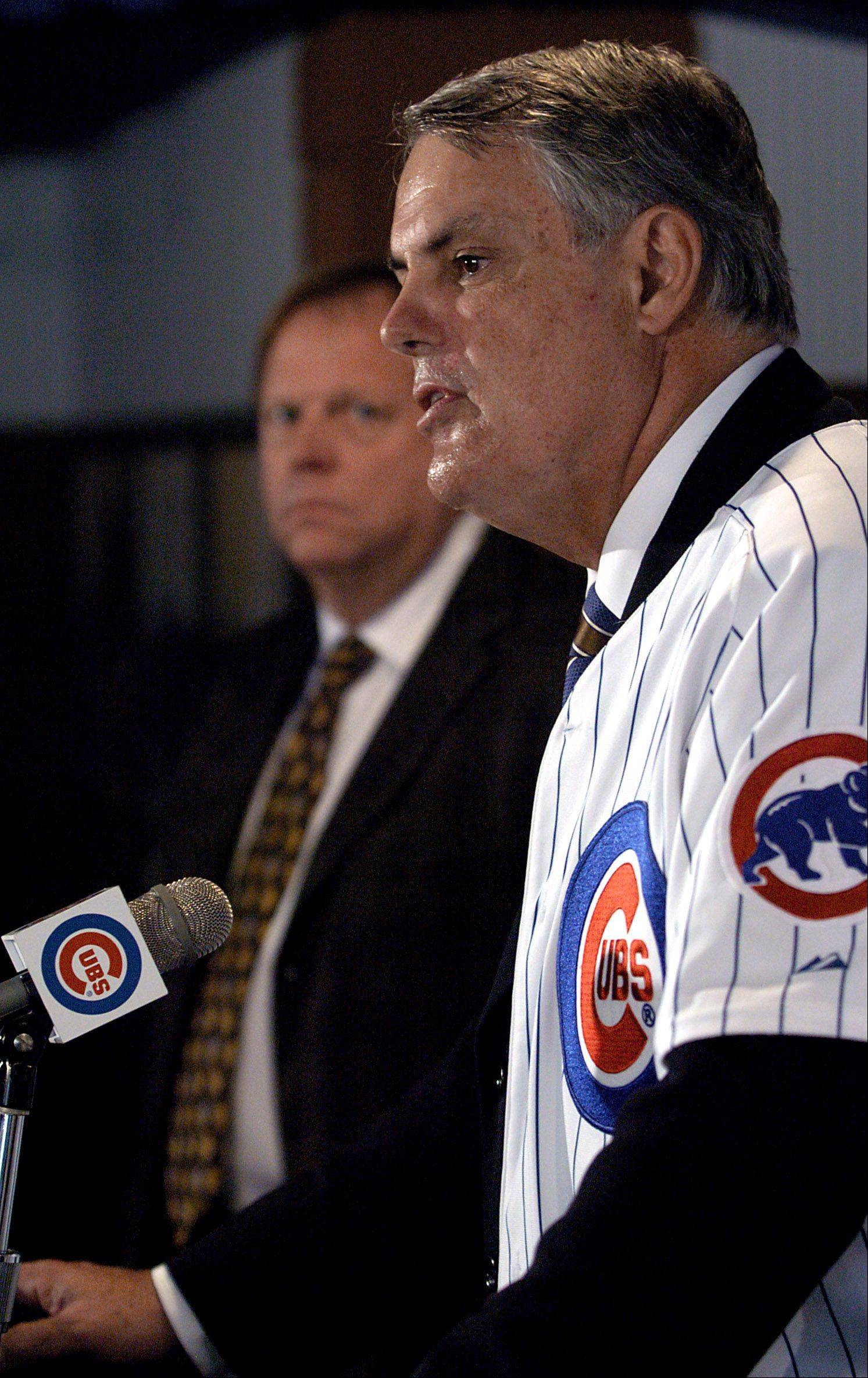 Chicago Cubs welcome new manager Lou Piniella to the club. New Cubs skipper Lou Piniella speaks to the media as GM Jim Hendry looks on.