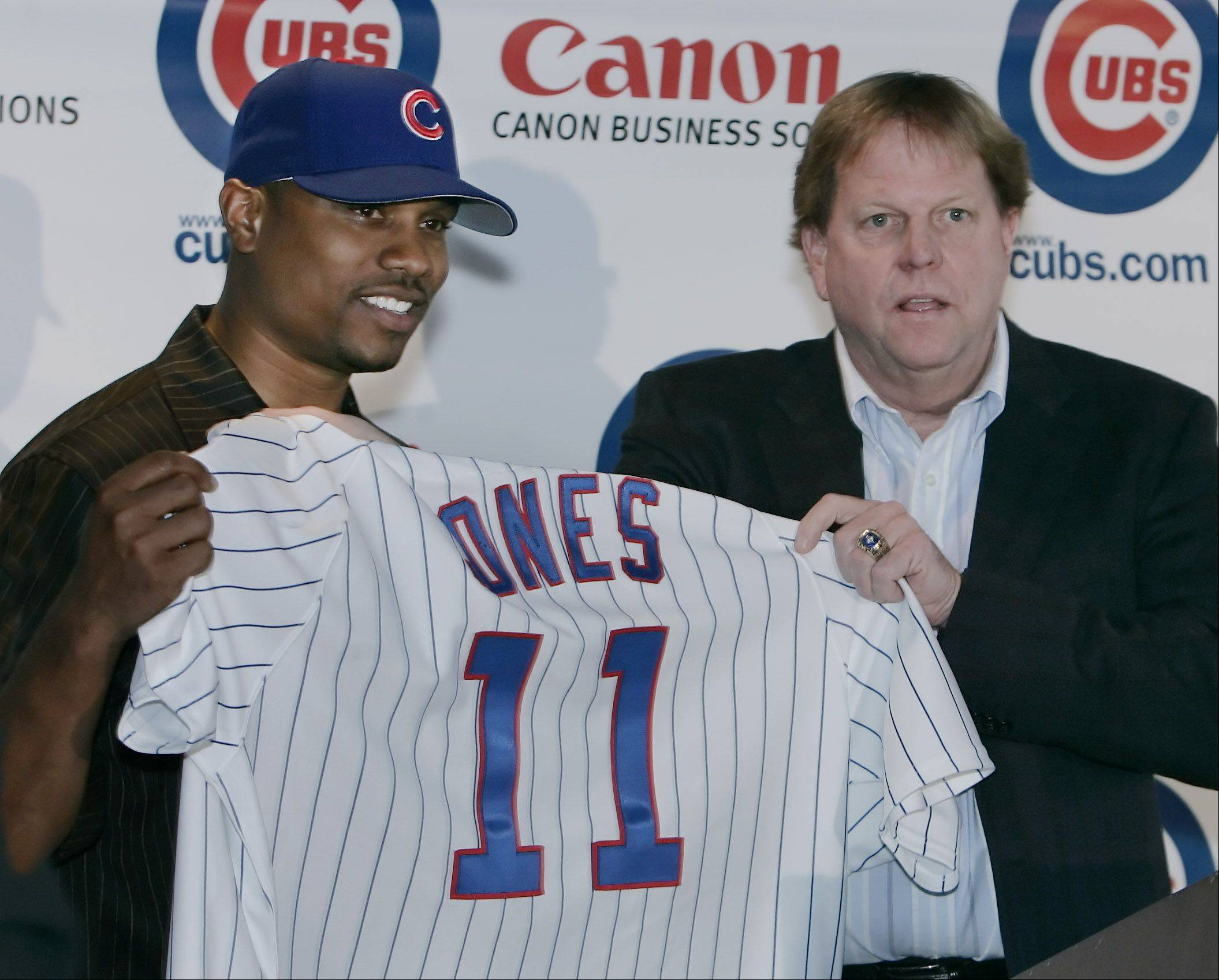 Chicago Cubs General Manager Jim Hendry introduced Jacque Jones as one of their new outfielders during a news conference at the Wrigley Field Stadium Club Restaurant in Chicago.