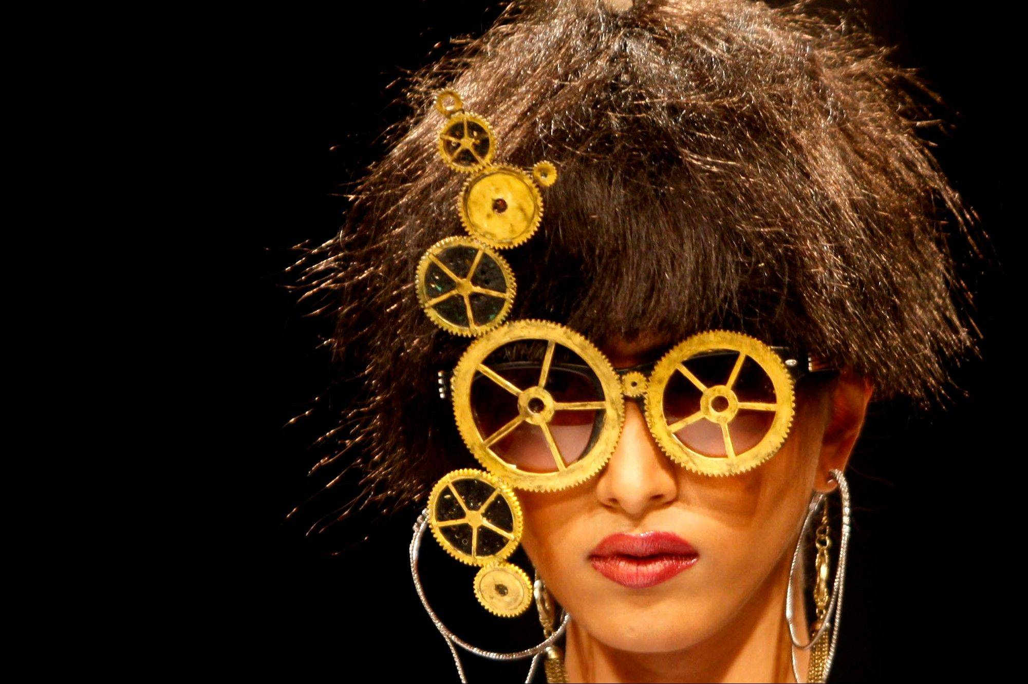 An Indian model displays a creation by designer Sidharta Aryan during Lakme Fashion Week in Mumbai, India.