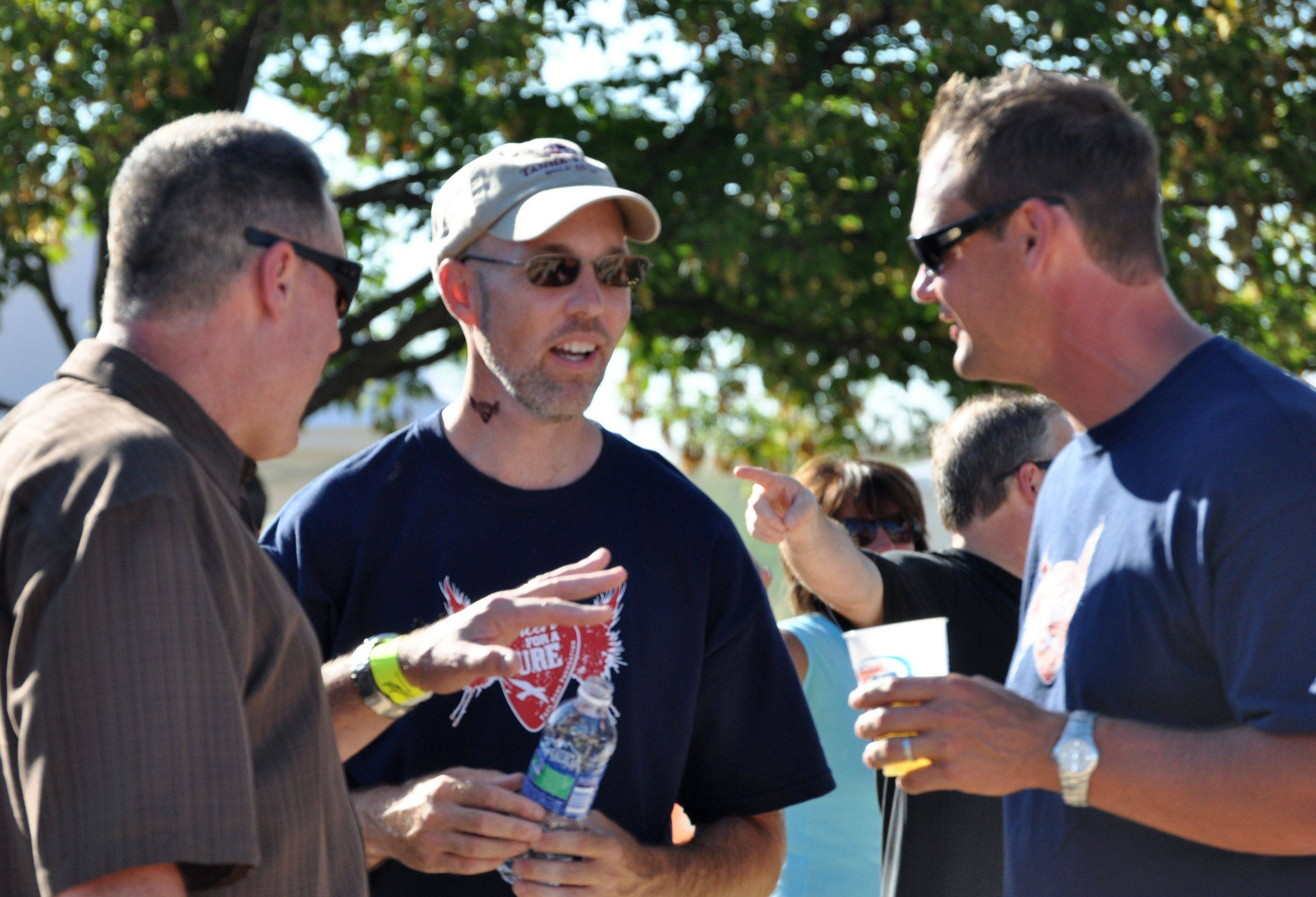 Paul Ruby, center, talks to guests at last year�s Concert for a Cure benefit for Parkinson�s disease. This year�s fundraiser for the Paul Ruby Foundation starts at 3 p.m. Aug. 27 at Tanna Farms, 39W808 Hughes Road, Geneva.