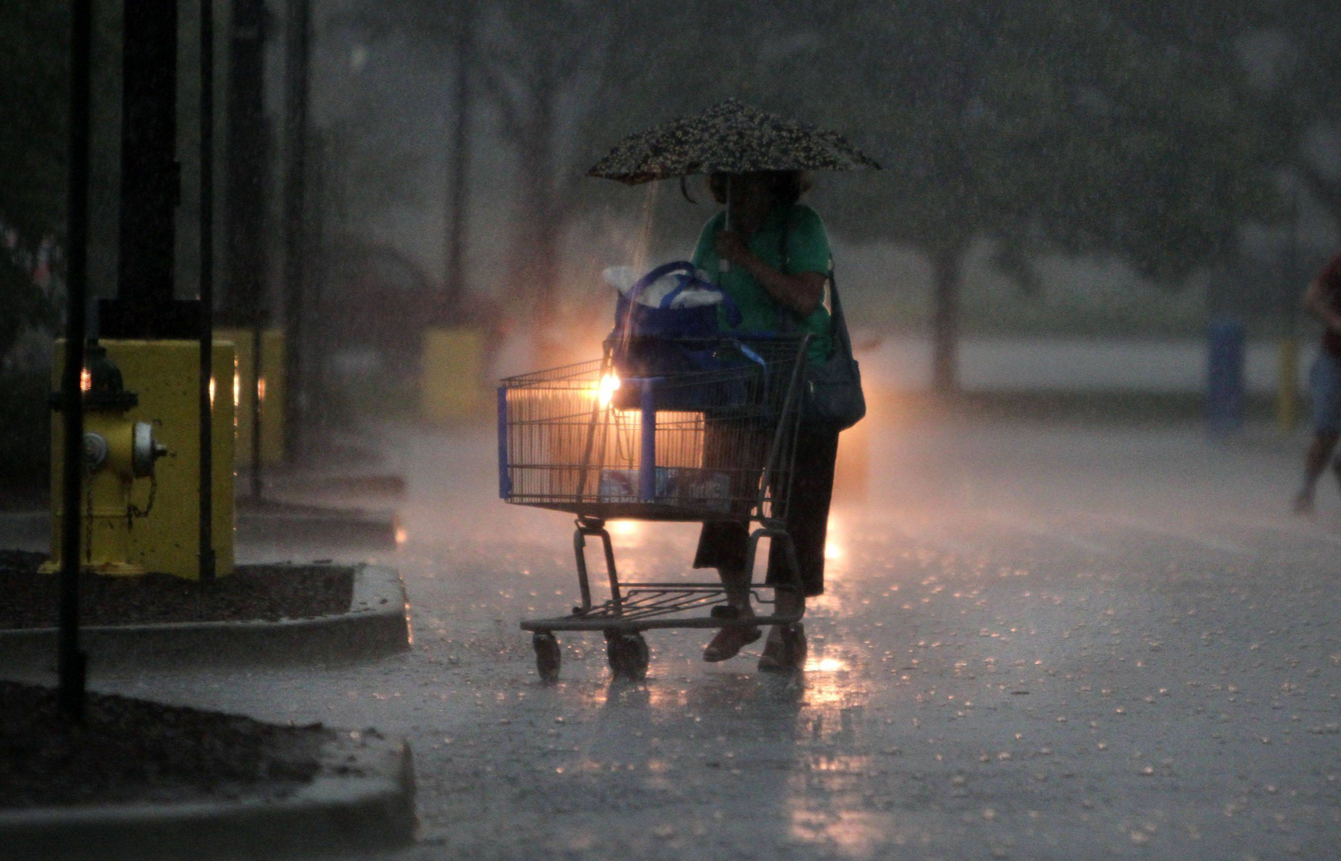 Heavy rain fell in Mount Prospect as Walmart shoppers rushed to their cars on Saturday.