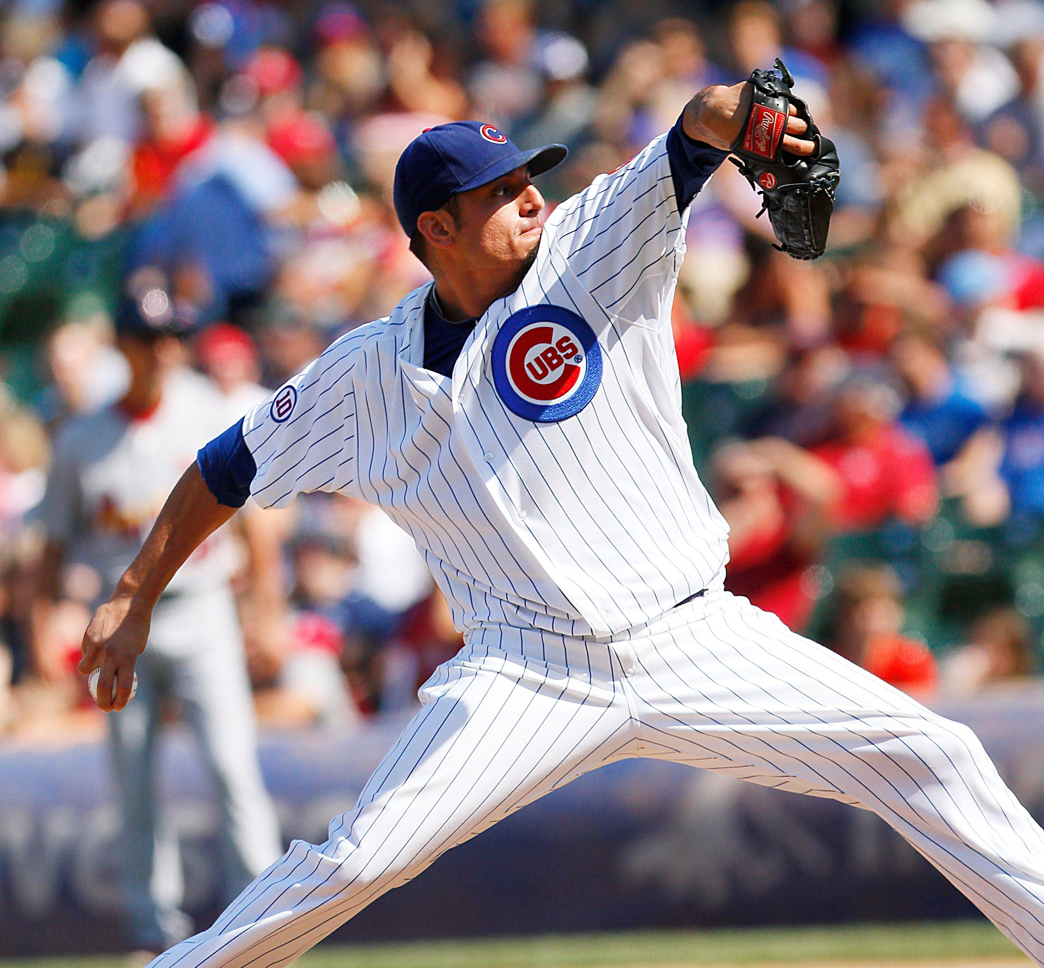 Starter Matt Garza scattered five hits, struck out 8 and won at Wrigley Field for the first time since June 27 as the Cubs topped the Cards 3-0.