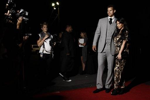 Kim Kardashian, right, and her fiance, NBA basketball player Kris Humphries, arrive at the Kardashian Kollection launch party in Los Angeles, Aug. 17. The Kardashian Kollection designed by the Kardashian sisters is available at Sears.