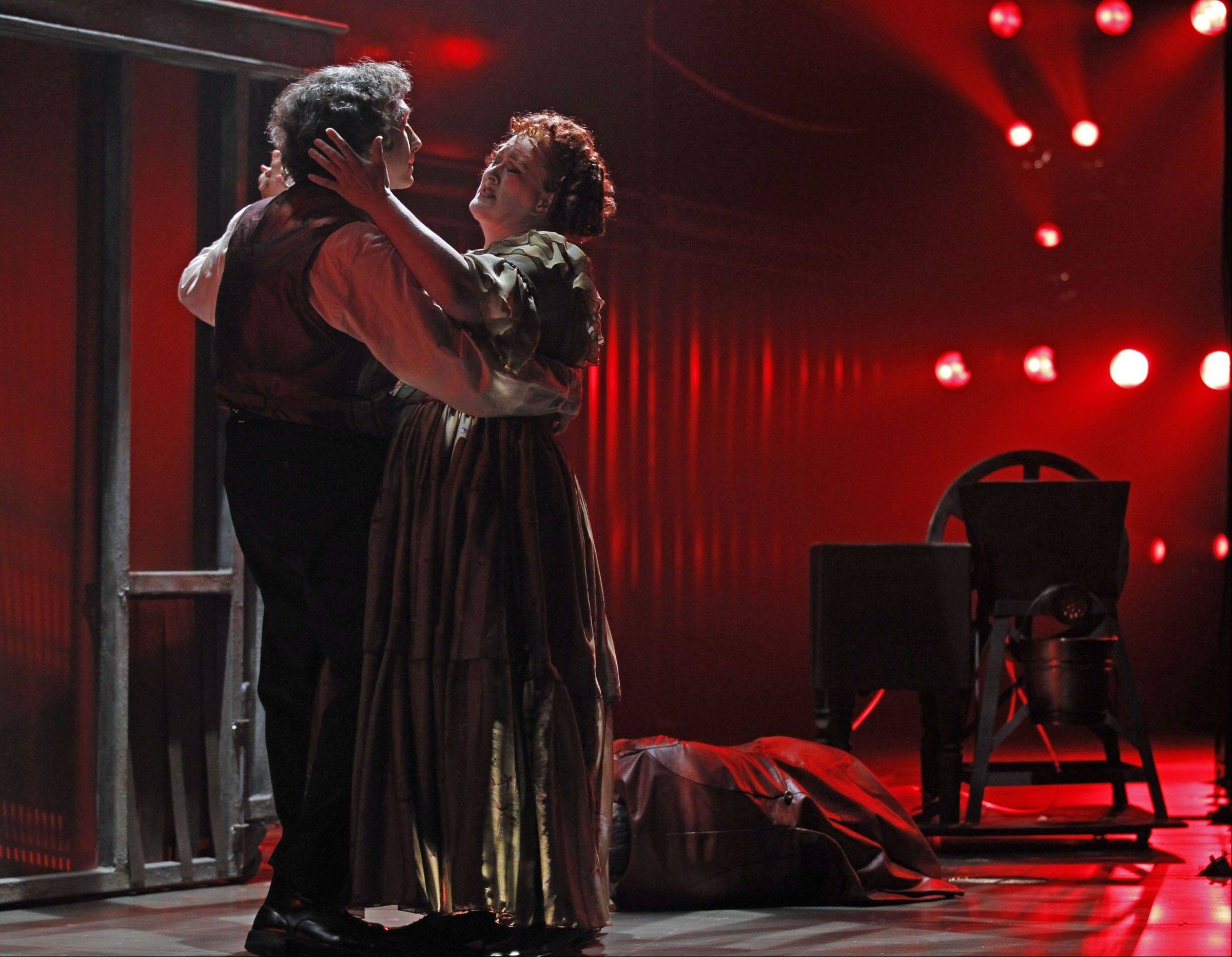 "Sweeney Todd (Gregg Edelman) and his partner-in-crime Mrs. Lovett (Liz McCartney) dance (almost literally) on the graves of their victims in Drury Lane Theatre's stellar production of Stephen Sondheim and Hugh Wheeler's masterwork, ""Sweeney Todd."""