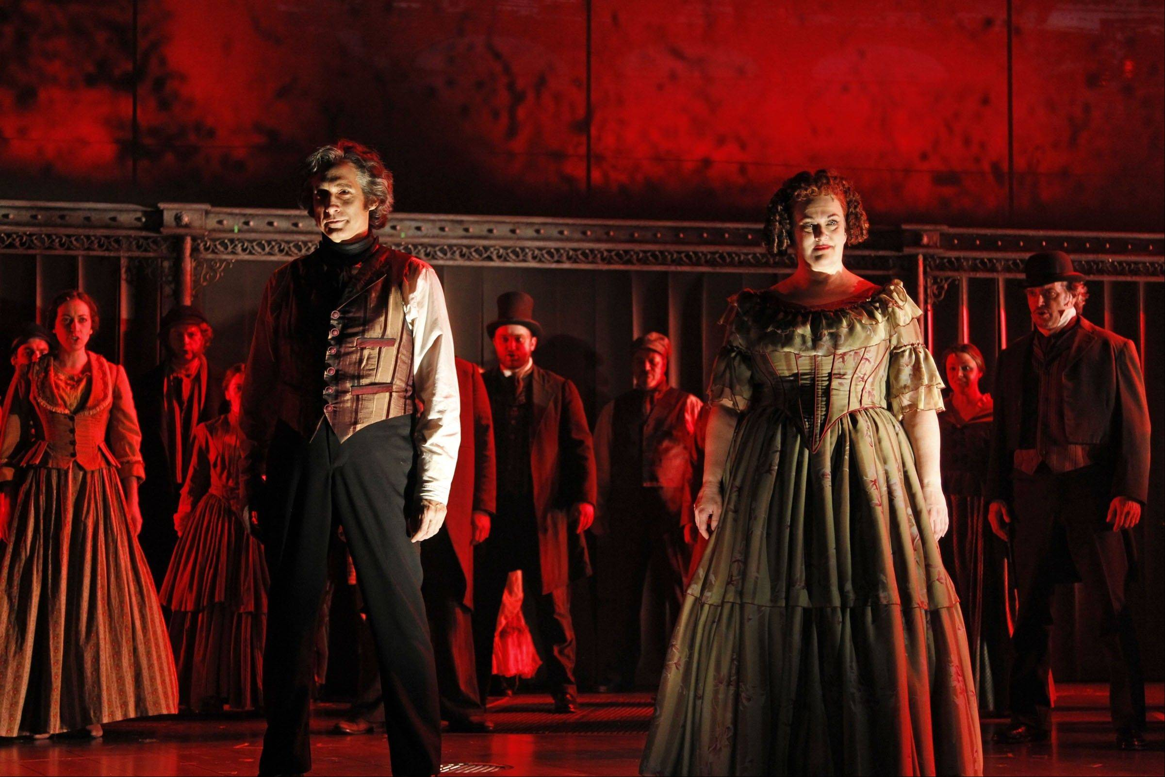 """Attend the tale of Sweeney Todd ..."" Drury Lane Theatre Oak Brook revives the Stephen Sondheim-Hugh Wheeler masterwork with blue-chip actors Gregg Edelman, left center, and Liz McCartney in the principle roles."