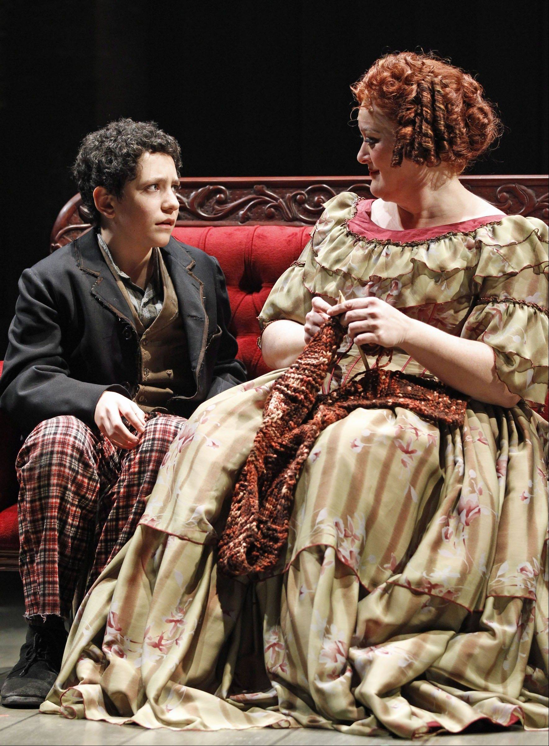 "The avaricious Mrs. Lovett (Liz McCartney) offers rarely seen affection to shop boy Tobias (Jonah Rawitz) in Drury Lane Theatre's ""Sweeney Todd."""