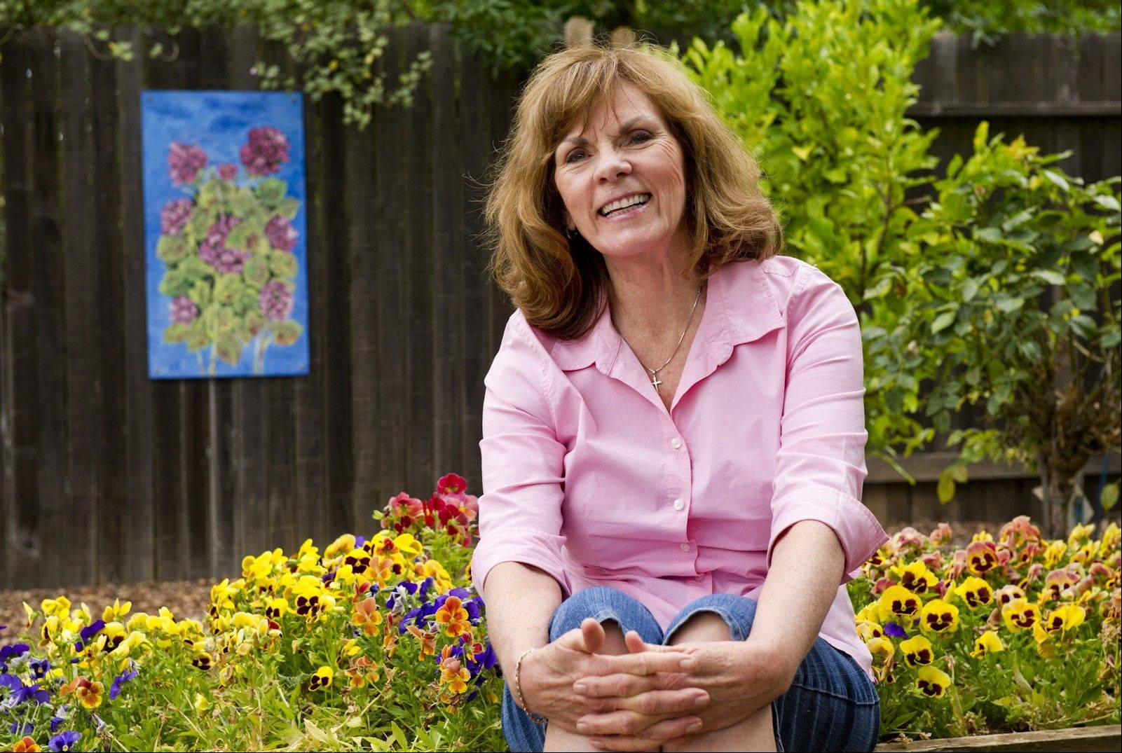 Carolyn Groth's paints colorful, weatherproof garden art that fills a niche as homeowners dress up their outdoor spaces.