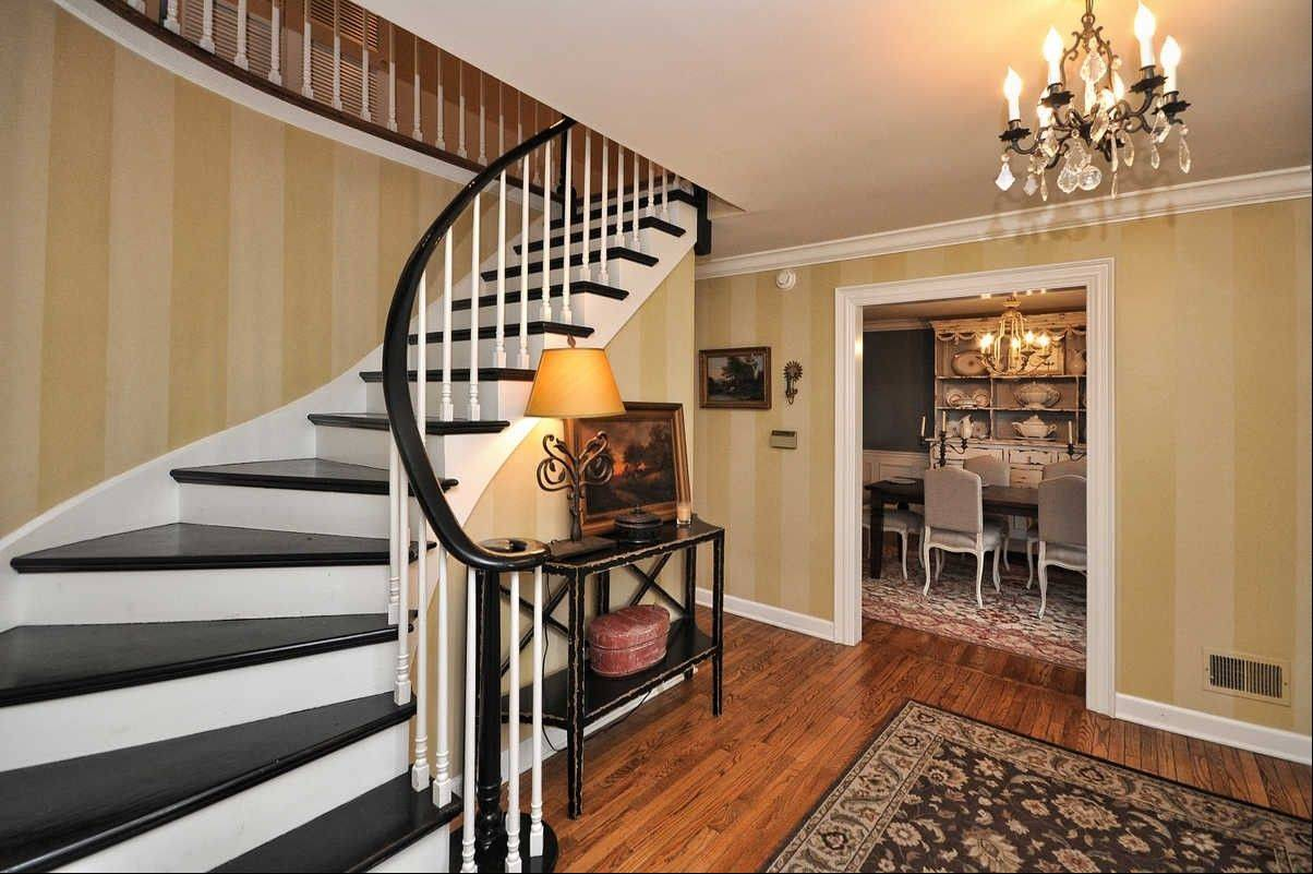 A winding staircase is the centerpiece of this five-bedroom home in Arlington Heights.