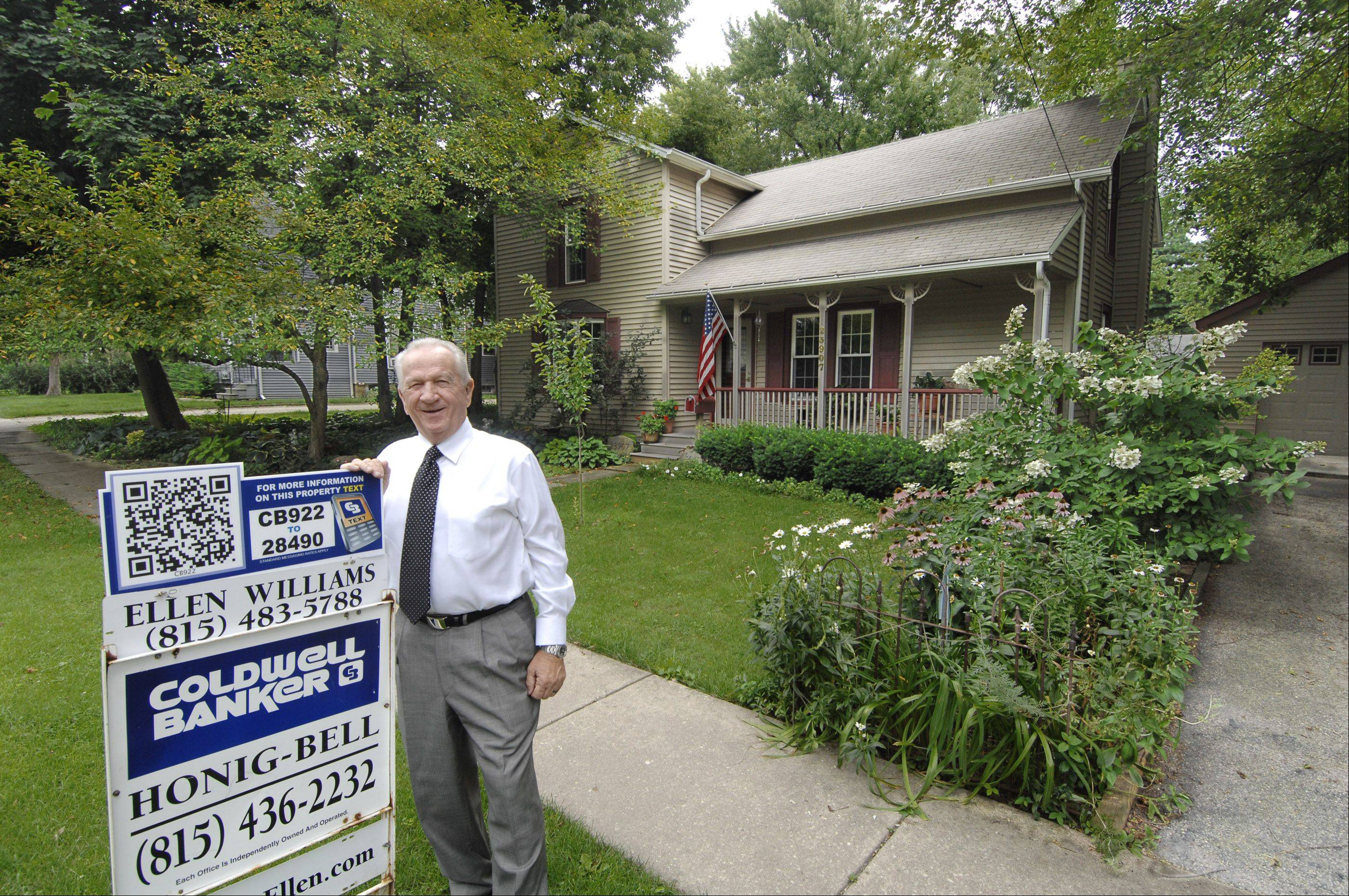 Scott Sanders/ssanders@dailyherald.comRealtor Ed Prodehl of Coldwell Banker is shown outside a listing in Plainfield.