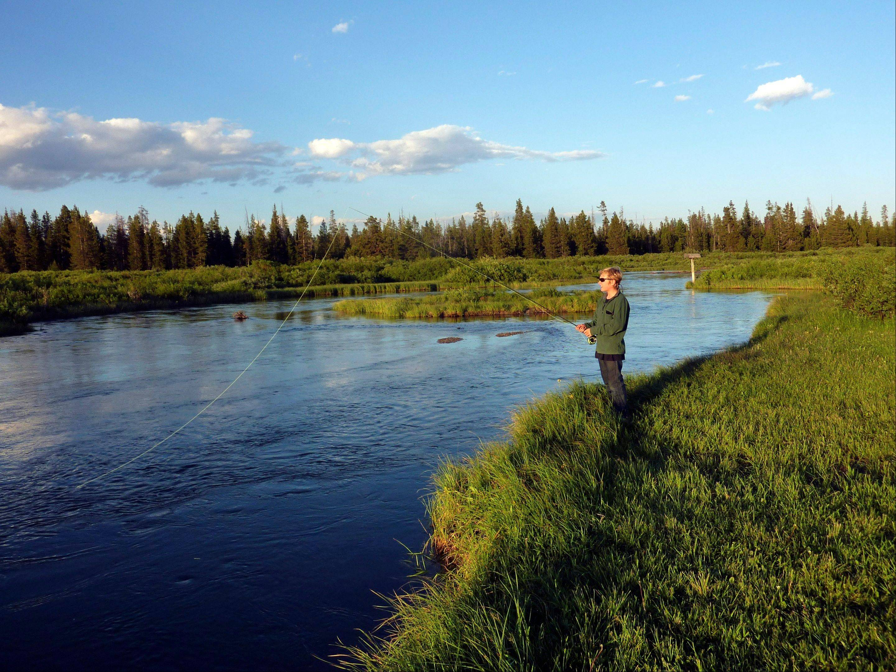 Evan Butler fishes the South Fork of the Madison River near West Yellowstone, Mont. Twin Bridges has many options for fishing locations.