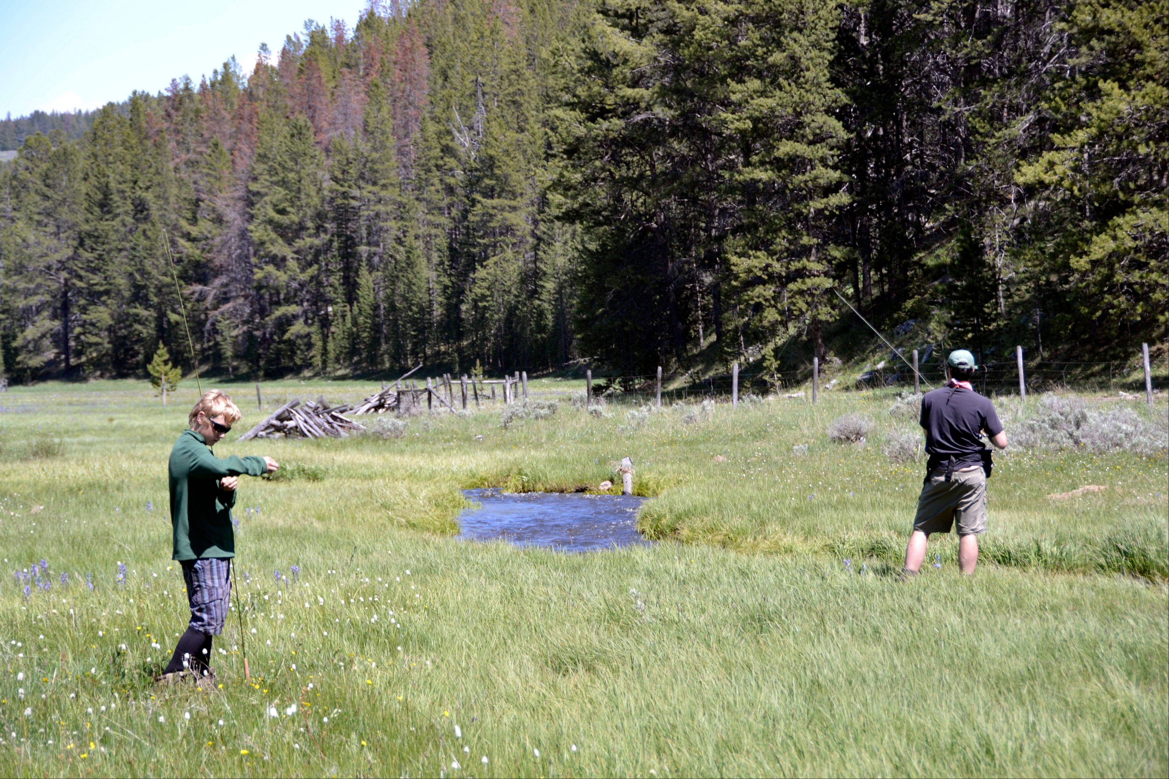Desmond, right, and Evan Butler fish the Selway Fork of Bloody Dick Creek near Dillon, Mont. The creek's lazy current winds through an open meadow.