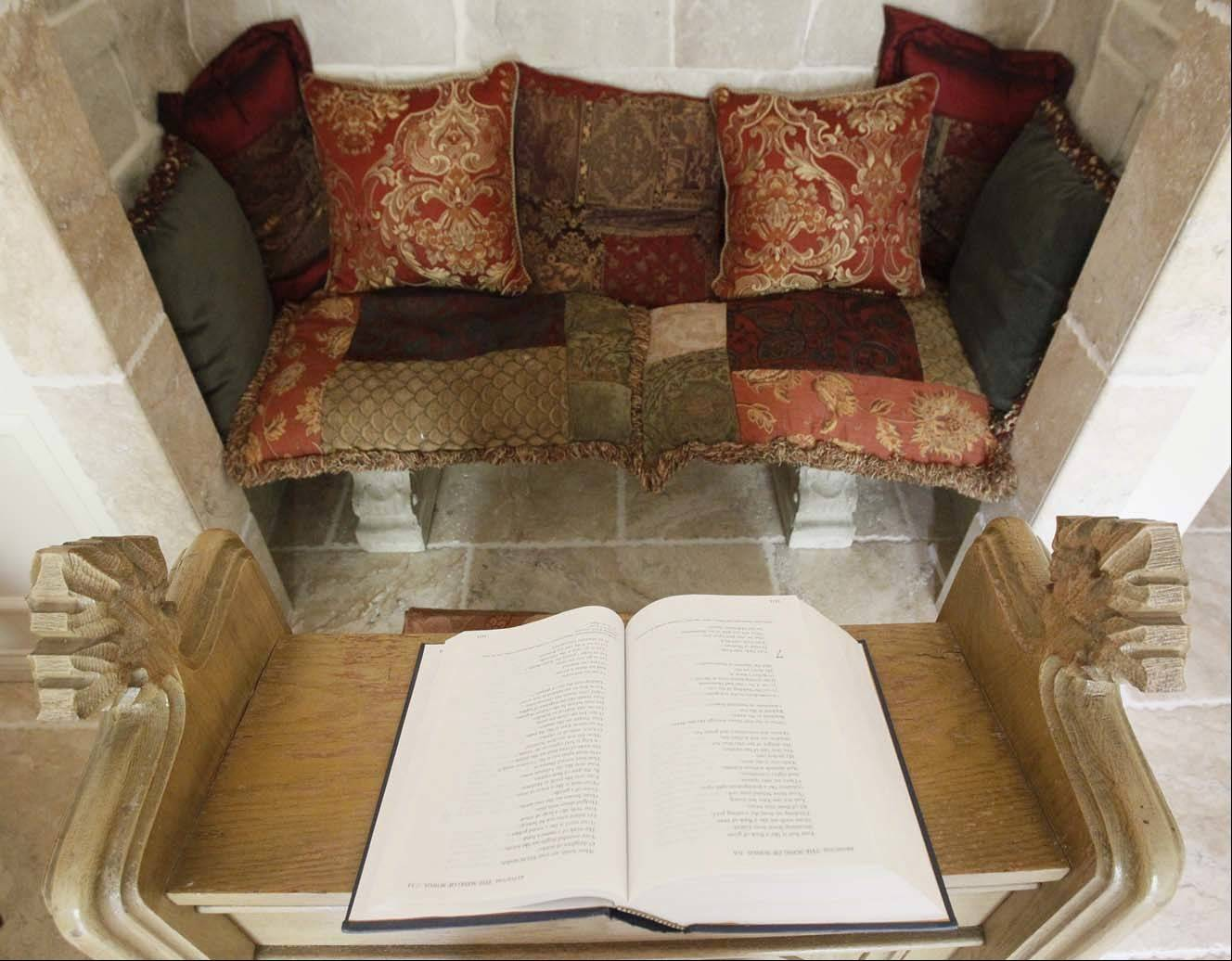 A closet in the former bedroom gave way to this stone prayer and reading alcove.