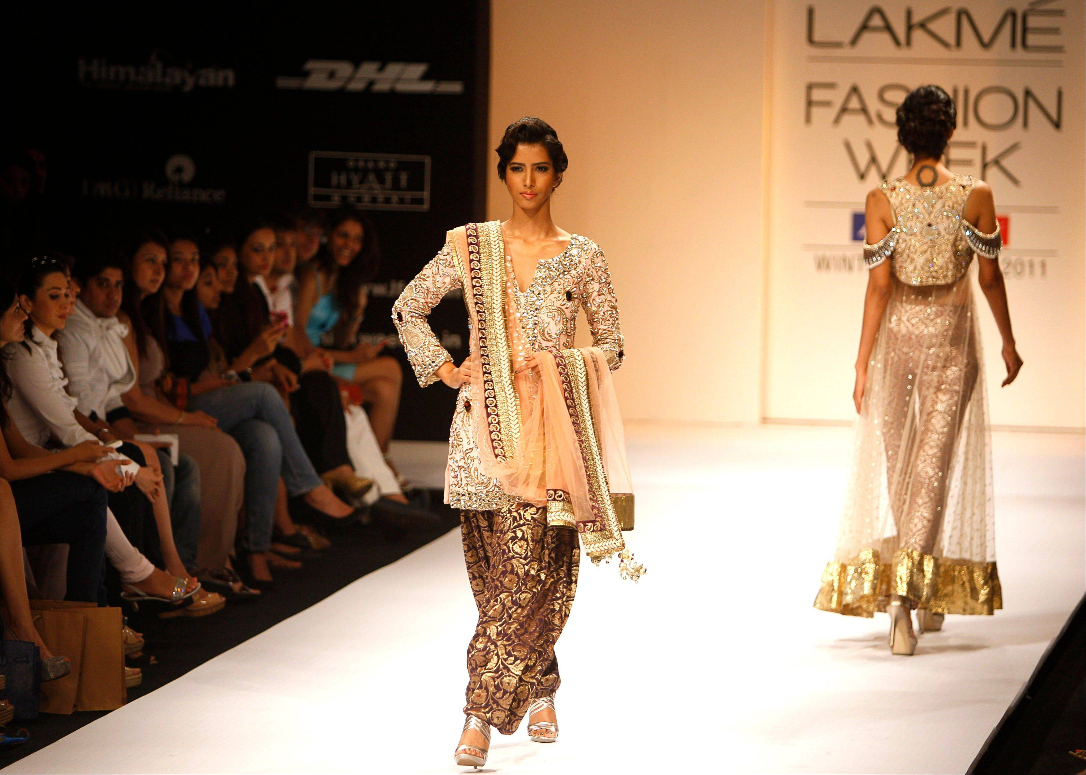 Indian models display creations by designer Payal Singhal during the Lakme Fashion Week in Mumbai, India.