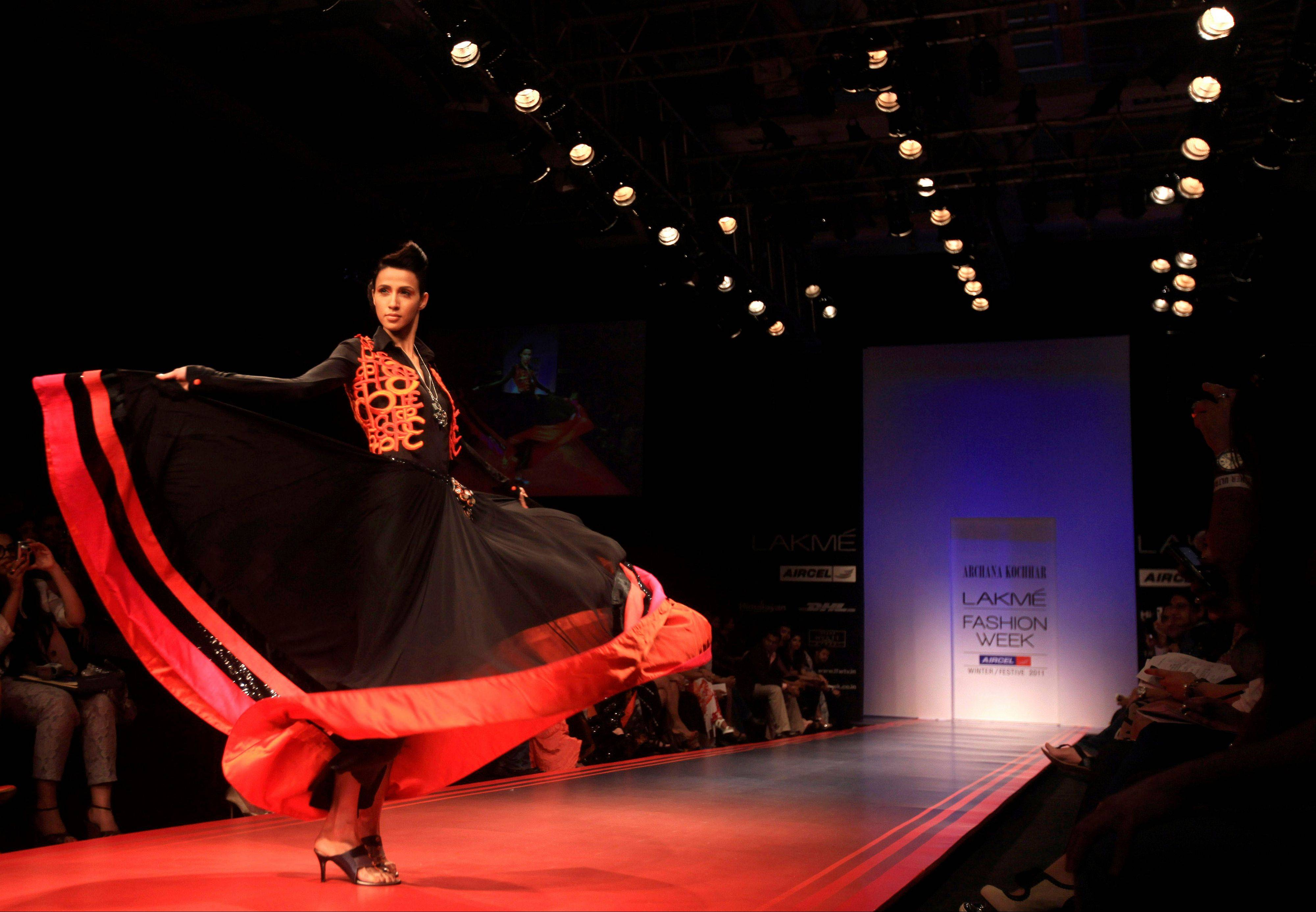 An Indian model displays a creation by designer Archana Kochhar during Lakme Fashion Week in Mumbai, India.