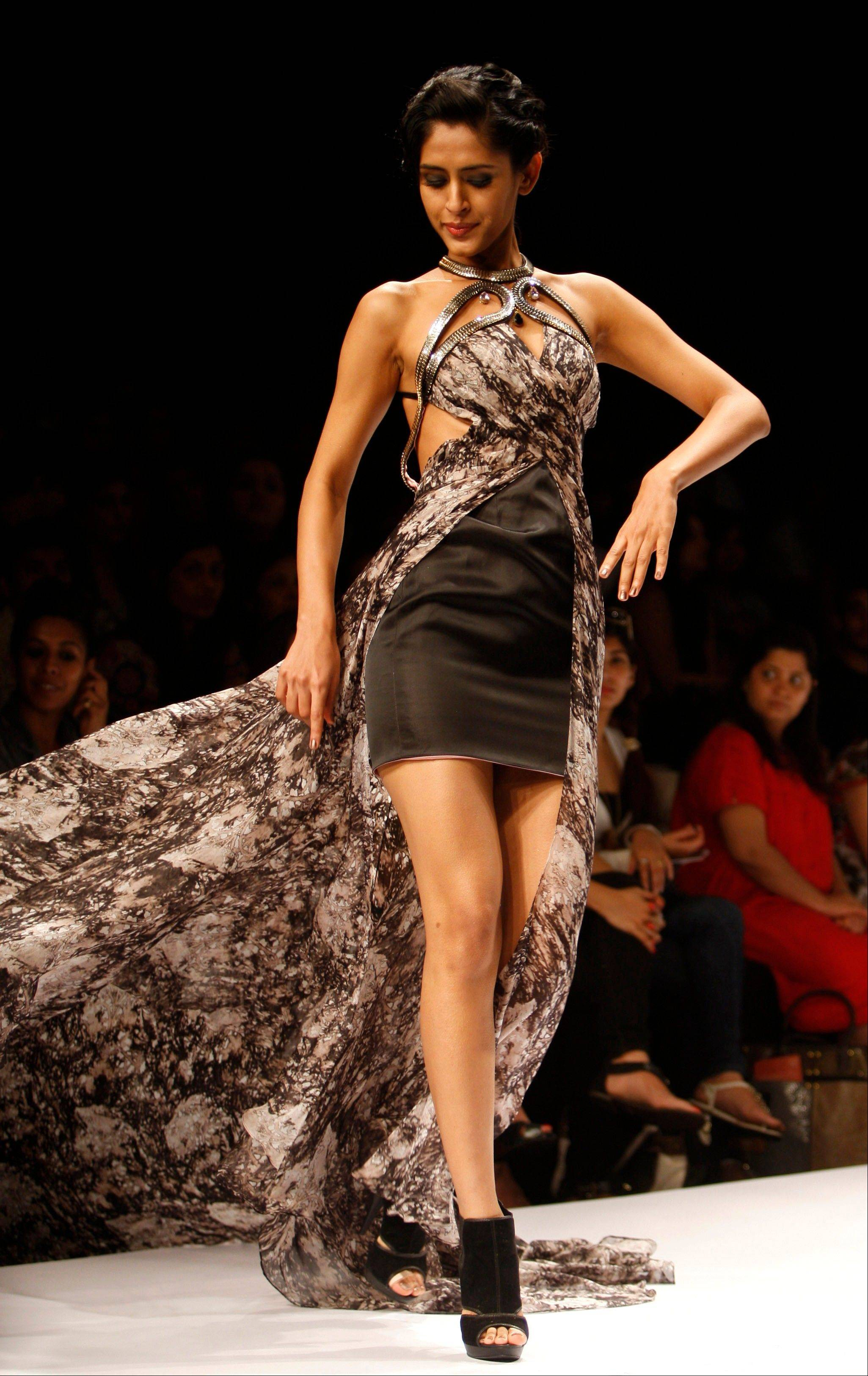An Indian model displays creations by designer Jatin Verma during the Lakme Fashion Week in Mumbai, India.