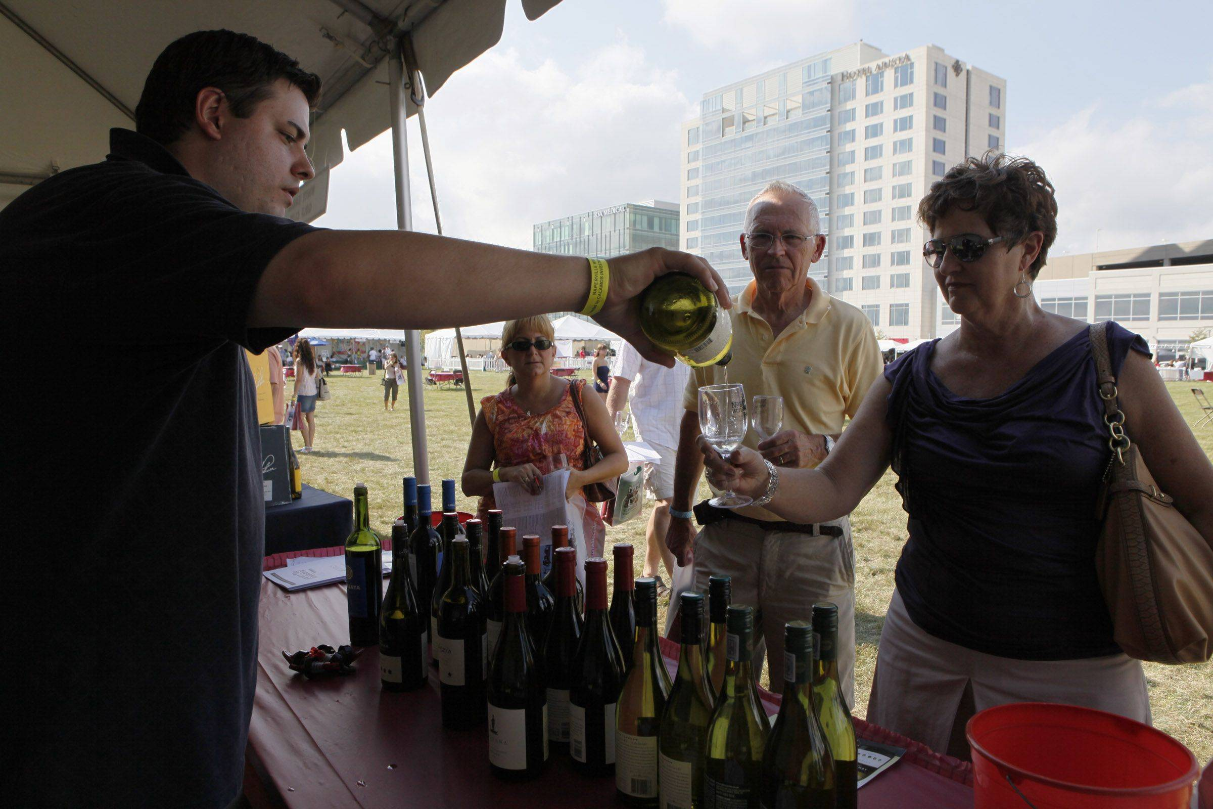 Karen Crawshaw samples one of the many wines available Saturday at the Naperville Wine Festival at CityGate Centre with her husband, Claude. John Redmond, who represents Heritage Wine Cellars, got into wine because he had a passion for it.