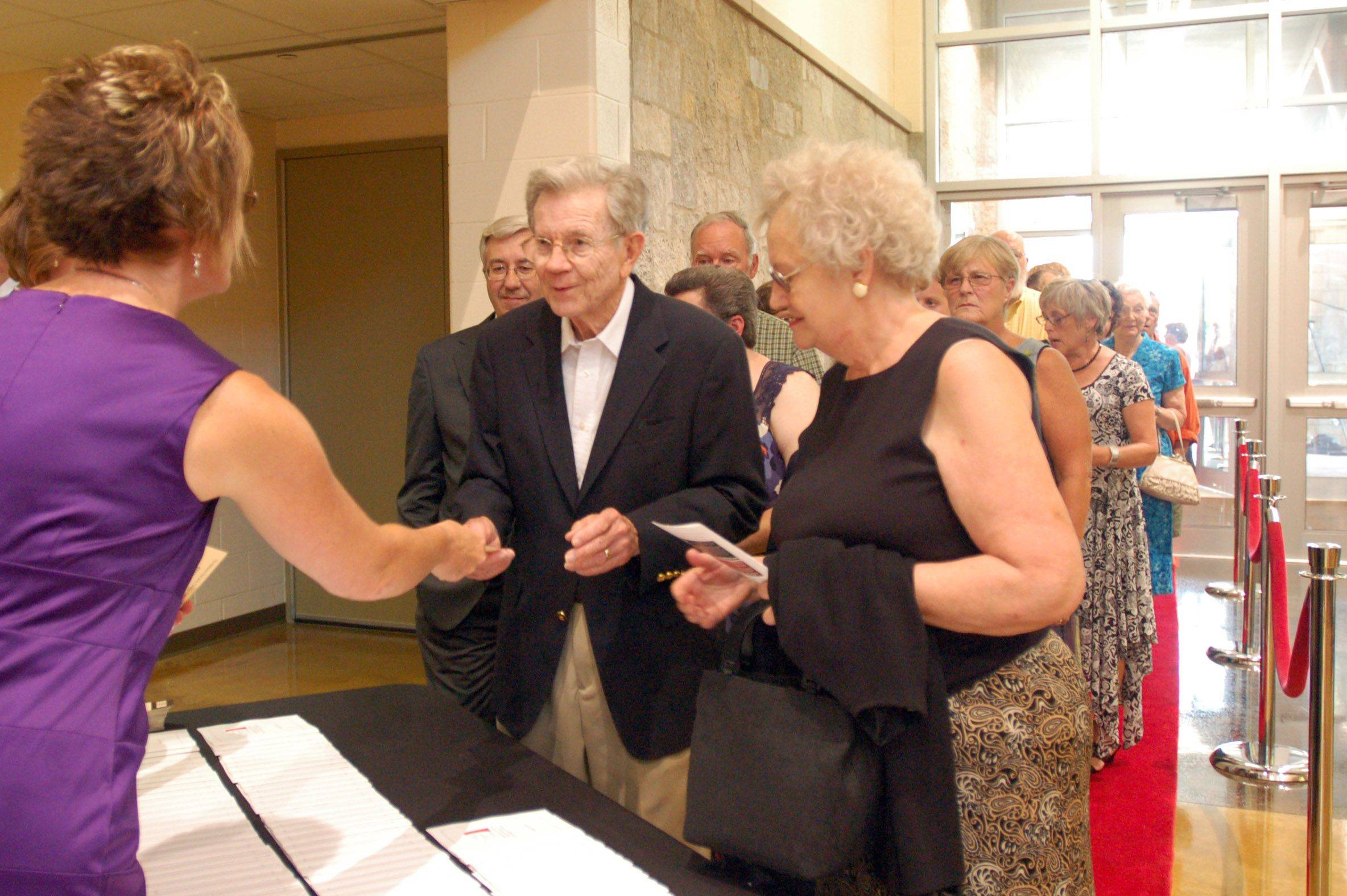 Rolla and Rosalind Swanson check in during the Batavia Fine Arts Centre's Red Carpet Gala opening on Saturday. The couple live a couple blocks from Batavia High School. The arts center is the school's first real auditorium, and will also serve as a community center for the city of Batavia.