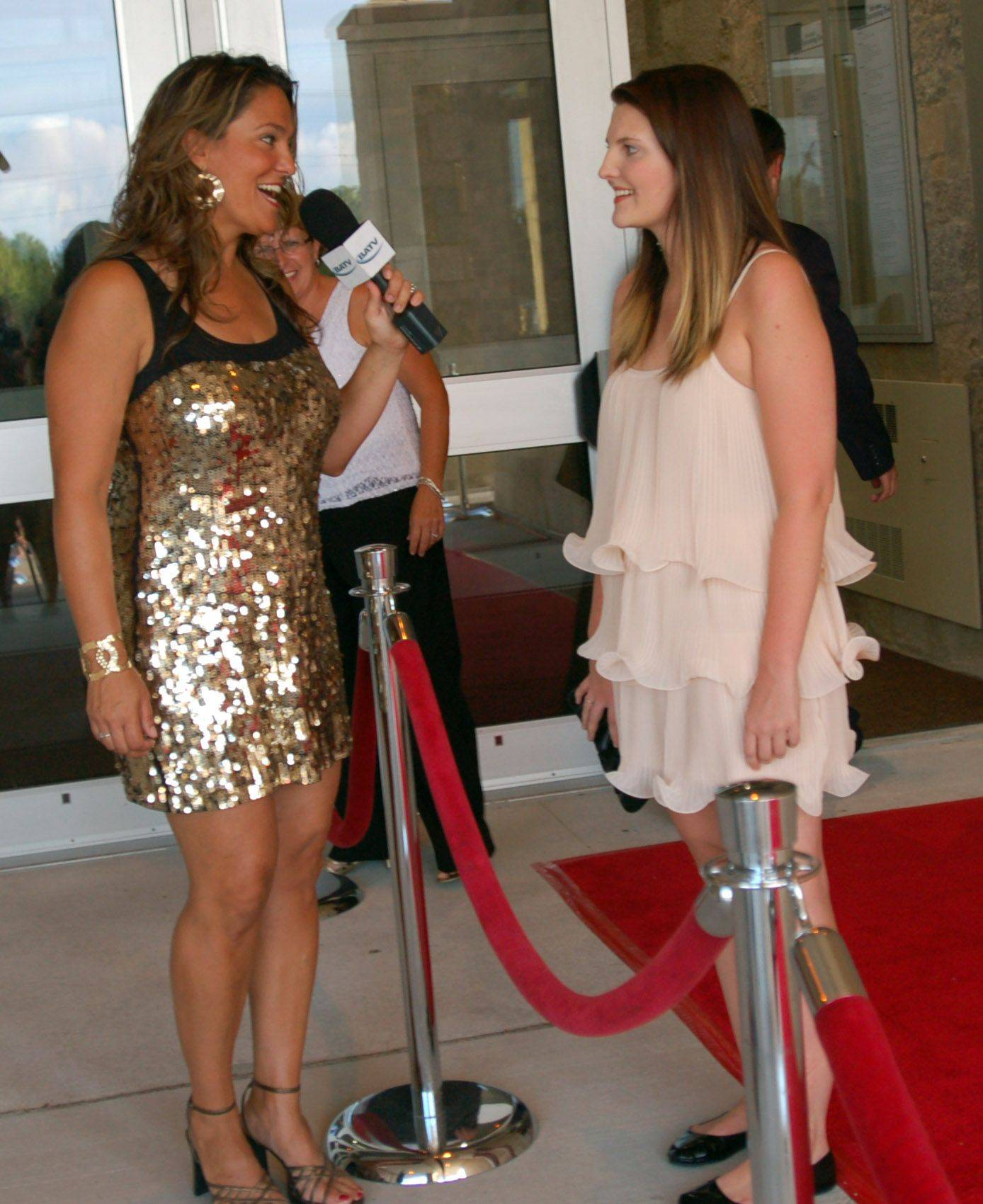 Allison Niemela of St. Charles, interviewed Maggie McHenry of Batavia, for Batavia Access Television during the Batavia Fine Arts Centre's Red Carpet Gala opening on Saturday. The arts center is the school's first real auditorium, and will also serve as a community center for the city of Batavia.