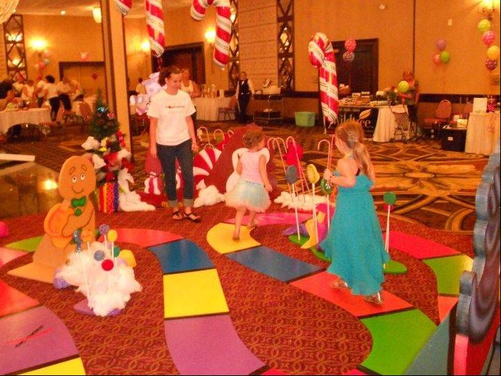 Villa Park Recreation Department Program Supervisor Mikie Rudyk, left, watches Atia, center, and a friend play Life Size Candy Land at Atia's Celebration of Life, held recently at Chateau Ritz in Niles. The event raised $8,500 for Atia's Project Ladybug Fund, a nonprofit organization that helps children with cancer and their families.