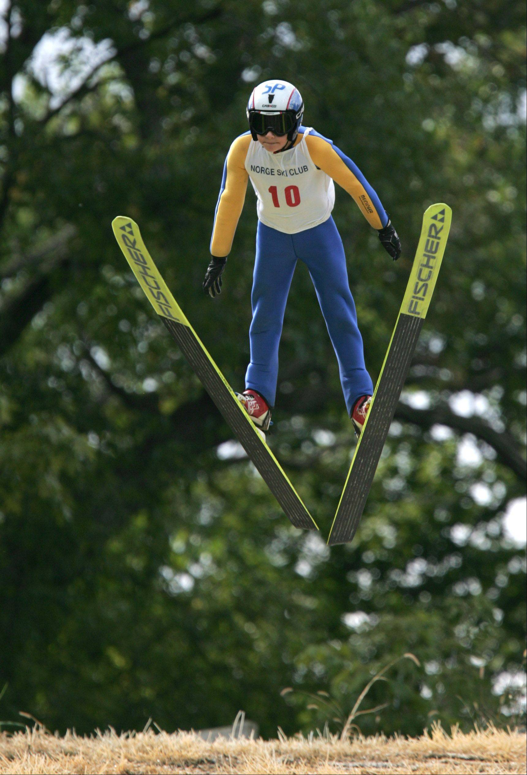Ben Loomis, 10, sails through the air at the Norge Ski Jump in 2009.