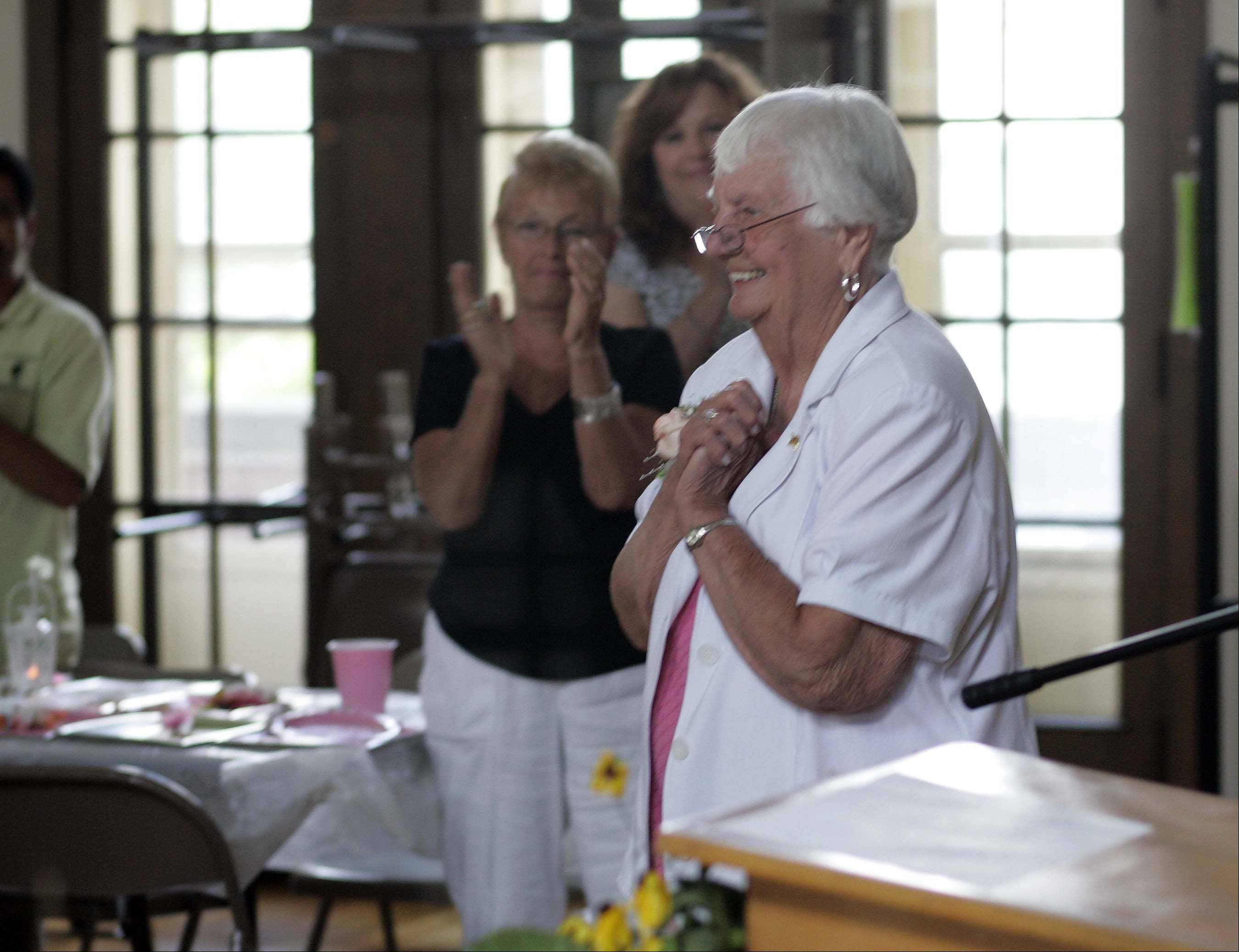 Carol Glemza, 87, will retire Sept. 1 after working for the St. Charles Park District for 69 years. Glemza was honored Friday with a retirement party at the Baker Community Center. Here she is overwhelmed by a standing ovation at the end of her retirement lunch.