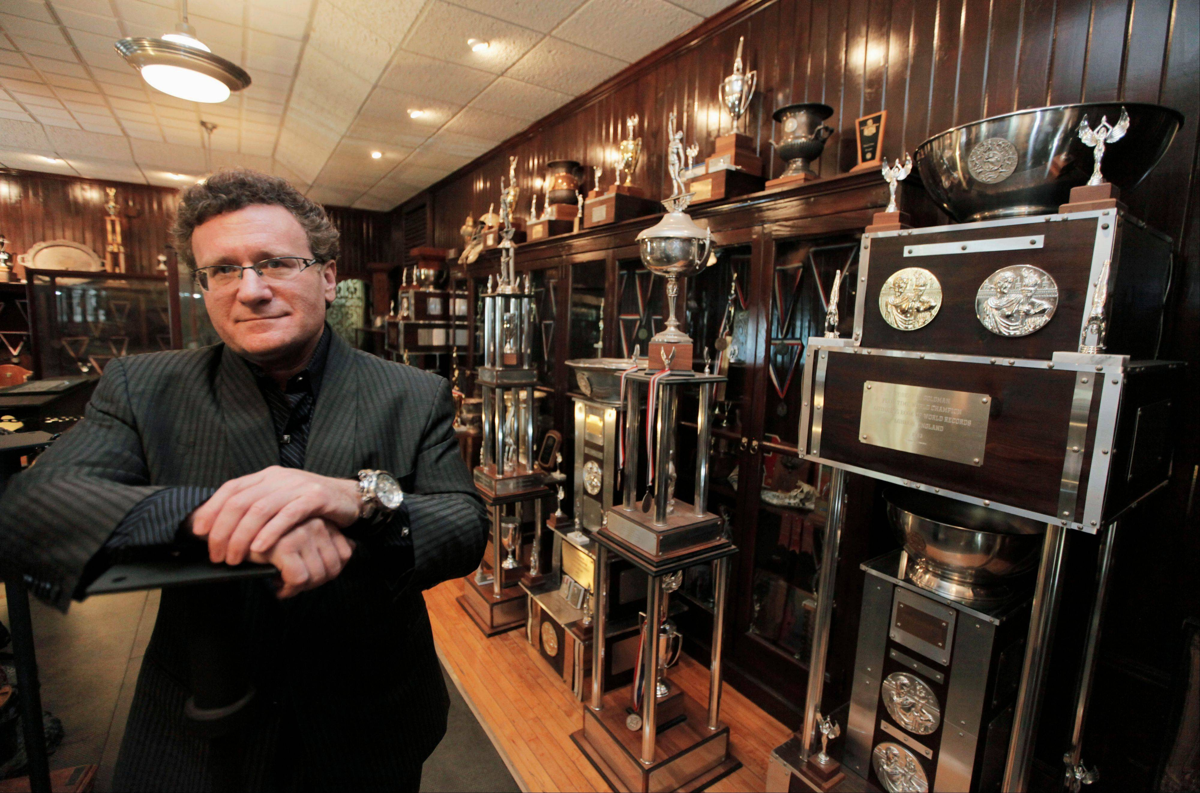 "Dr. Robert Goldman, one of the co-founders of the American Academy of Anti-Aging Medicine, is photographed in his trophy room in Chicago with hardware from 20 Guinness World Records for strength and endurance. ""People should be healthy and strong well into 100 to 120 years of age,"" Goldman says in a biographical video. ""That's what's really exciting - to live in a time period when the impossible is truly possible."""