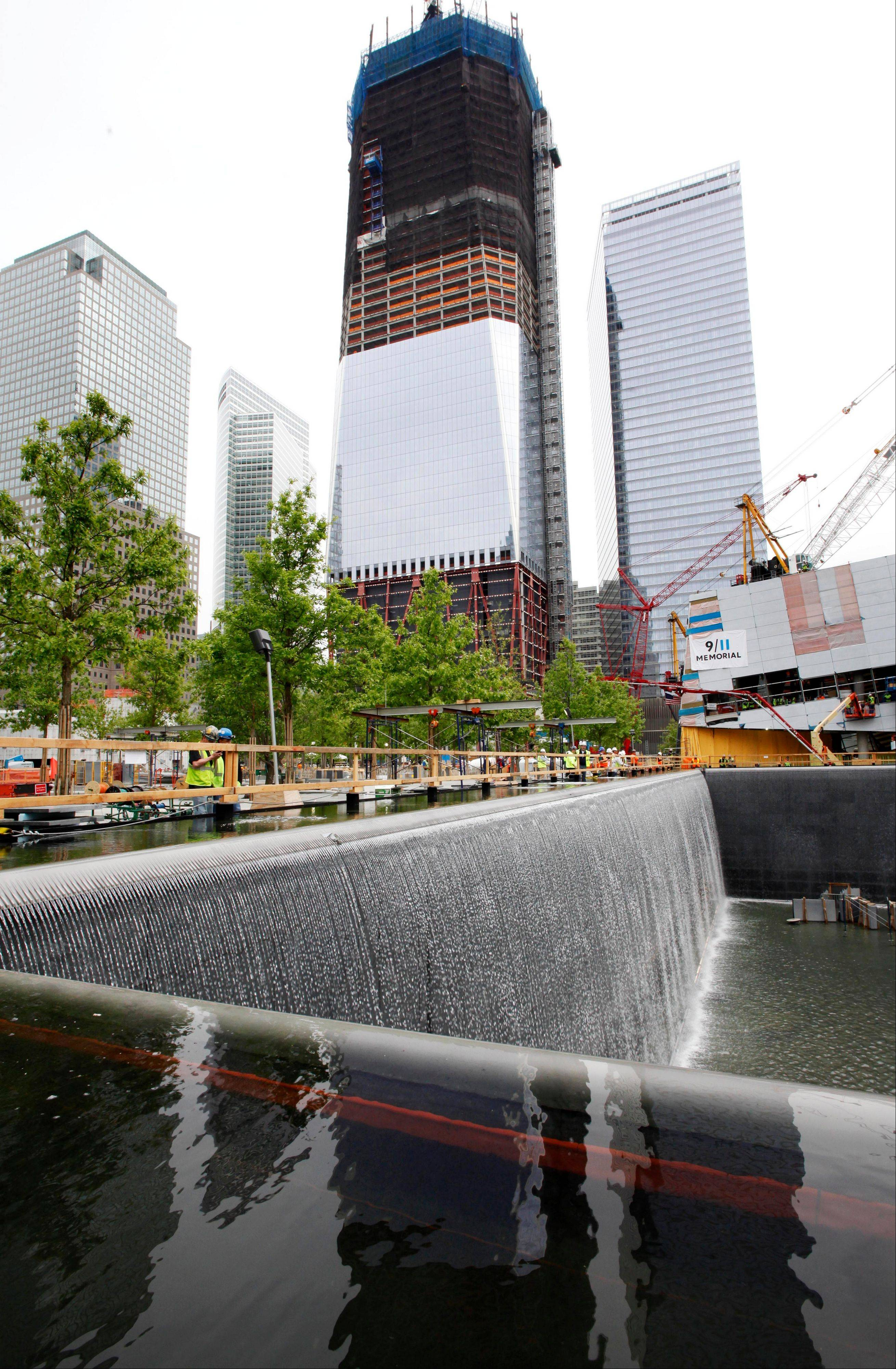 Waterfalls empty into a massive reflecting pool at the National September 11 Memorial.