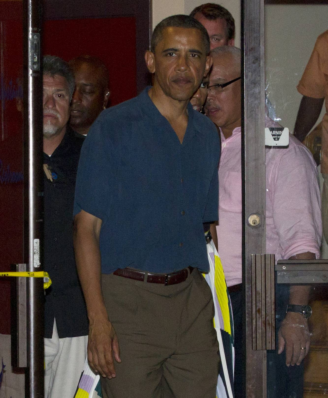 President Barack Obama leaves Nancy's Restaurant on Sunday in Oak Bluffs on Martha's Vineyard, Mass., during a family vacation. Obama was briefed throughout the day on the latest developments in Libya.