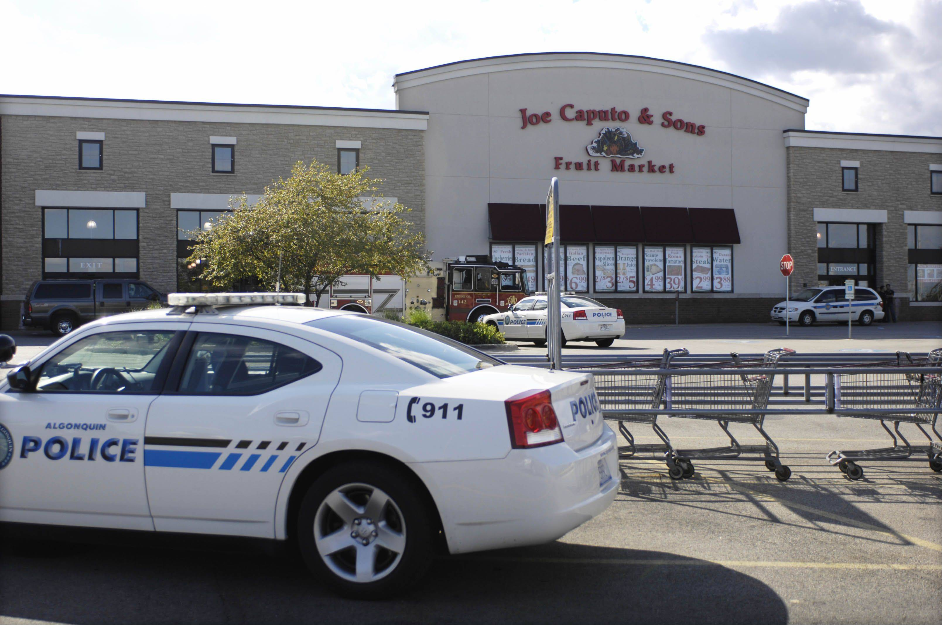 Police block off the parking lot of Joe Caputo & Sons Fruit Market Sunday on Randall Road in Algonquin after a man walked into the store with a Molotov cocktail and threw it into a crowd, injuring one shopper. A 24-year-old Sleepy Hollow man was arrested and charged with aggravated arson.