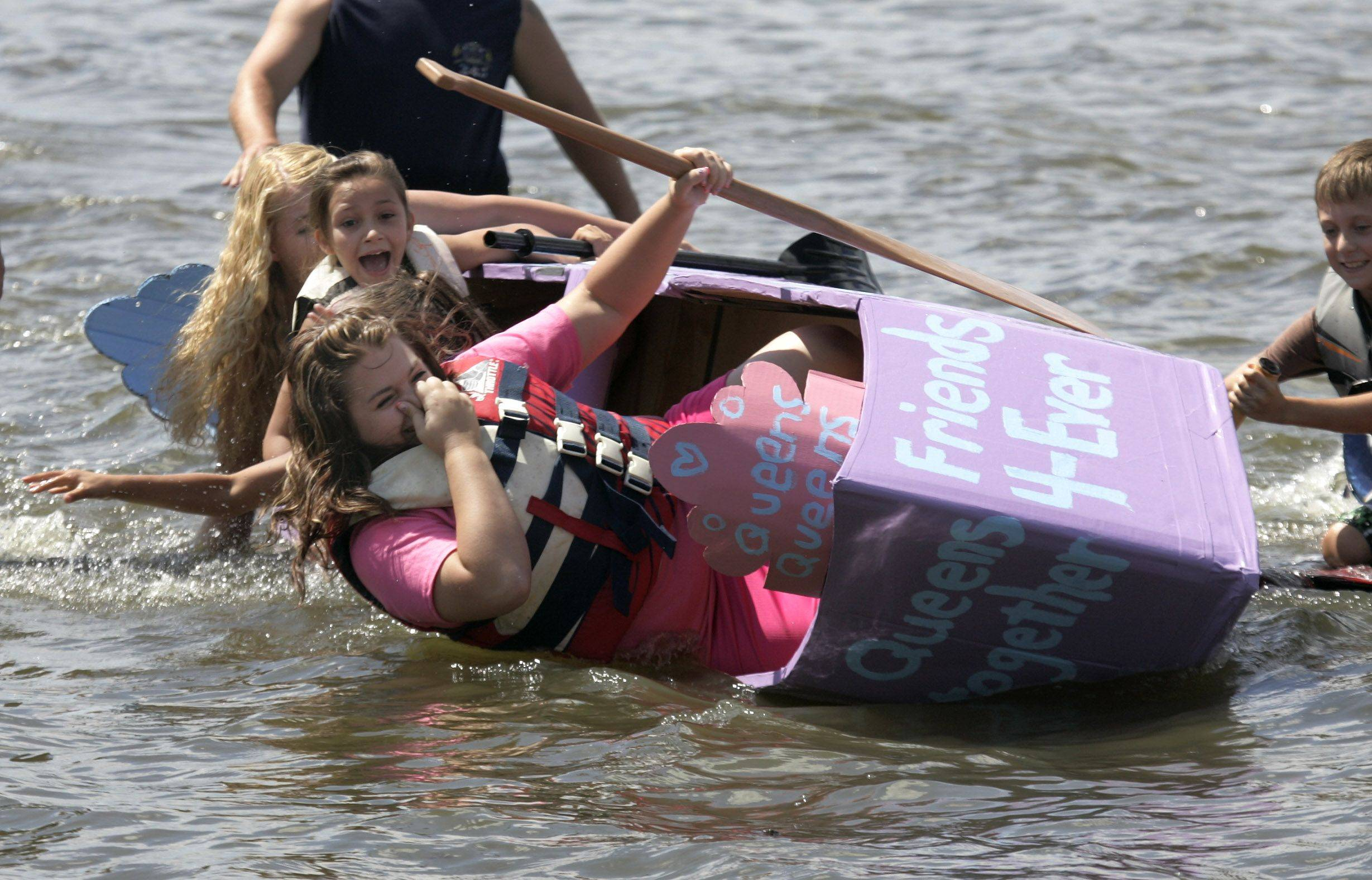 Grant Township Queen Samantha Murphey holds her nose as the �Queen�s Boat� tips during Fox Lake�s 14th Annual Cardboard Cup Regatta on Sunday at Lakefront Park. Also in the boat were Junior Miss Madison Point, Little Miss Lainie Noda, and Teen Miss Katie Rehling.