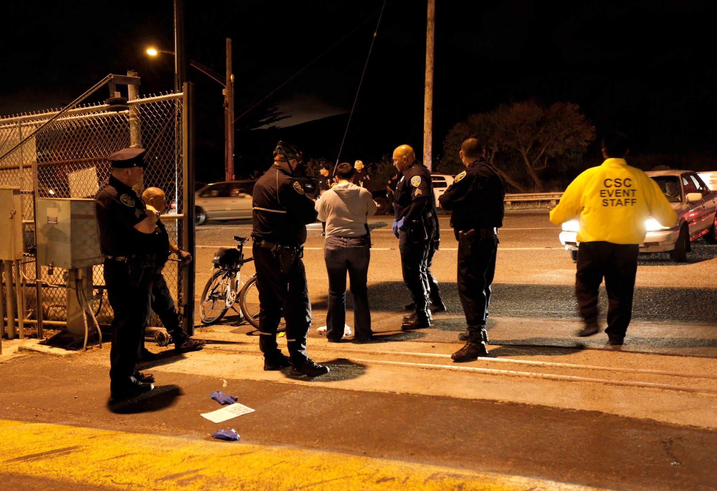 Police officers investigate the scene of a shooting just outside of lot L at Candlestick Park, where the San Francisco 49ers had just finished playing the Oakland Raiders in San Francisco, Calif. on Saturday Aug. 20, 2011.