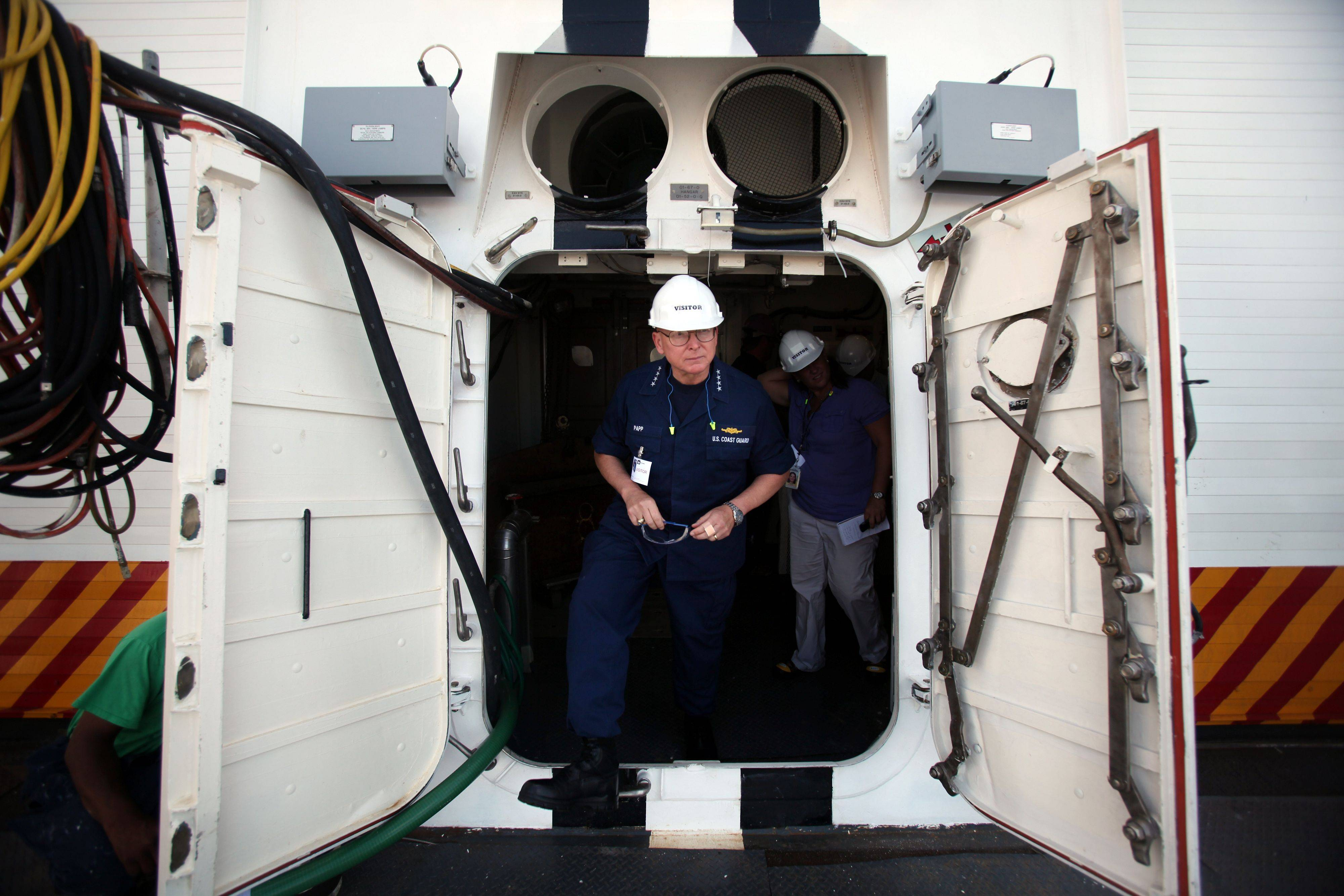 Adm. Robert J. Papp Jr. Commandant, U.S. Coast Guard walks onto the deck of the Coast Guard National Security Cutter Stratton (WMSL 752) during a tour of the new ship at Ingalls Shipbuilding in Pascagoula, Miss.