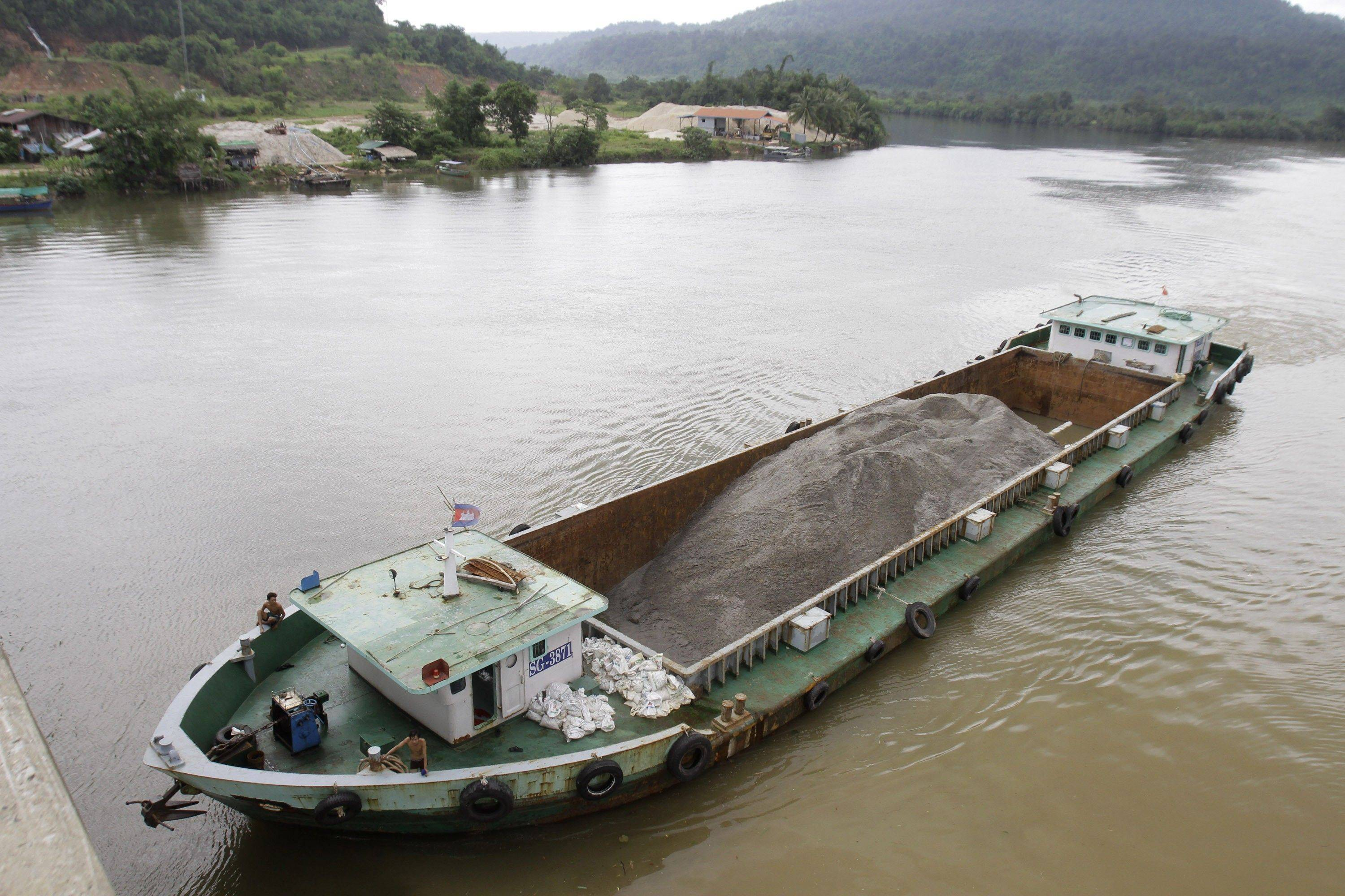 Vietnamese vessel haulssand plies the Tatai River in southwestern Cambodia. Cambodia is exporting vast amounts of sand for land reclamation and construction projects in Singapore.