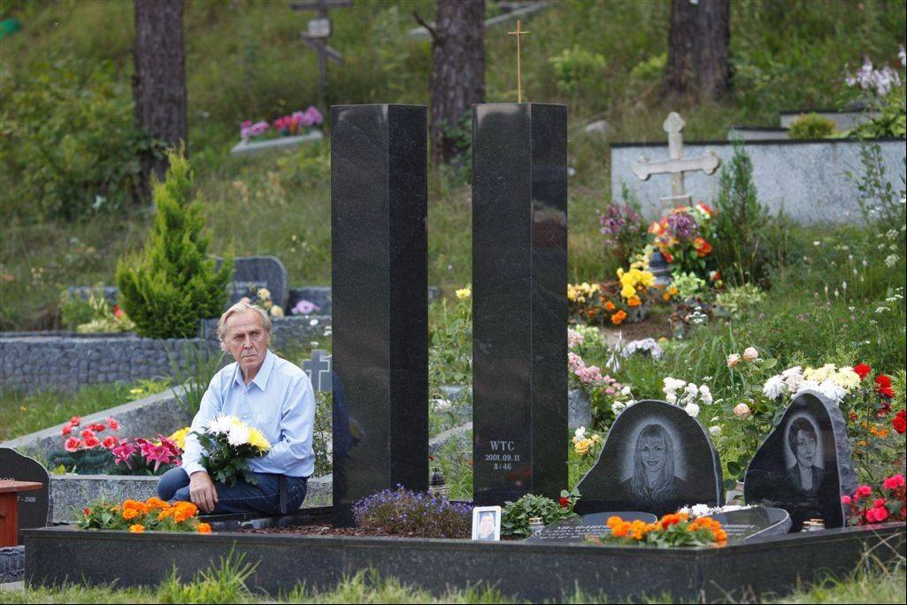 Vladimir Gavriushin sits at the grave he built for his daughter Yelena in a cemetery outside Vilnius, Lithuania. Yelena was one of the nearly 3,000 people killed on Sept. 11, 2001. Gavriushin has buried rocks from ground zero under these tombstone towers, far from the place Yelena died _ a place he can no longer afford to visit. And so, as the 10-year anniversary of the terrorist attacks approaches, he mourns for her here, at his own ground zero. He remembers frantically calling his daughter that day amid the terrified crowds in Brooklyn, where he was at the time: �She never answered.�