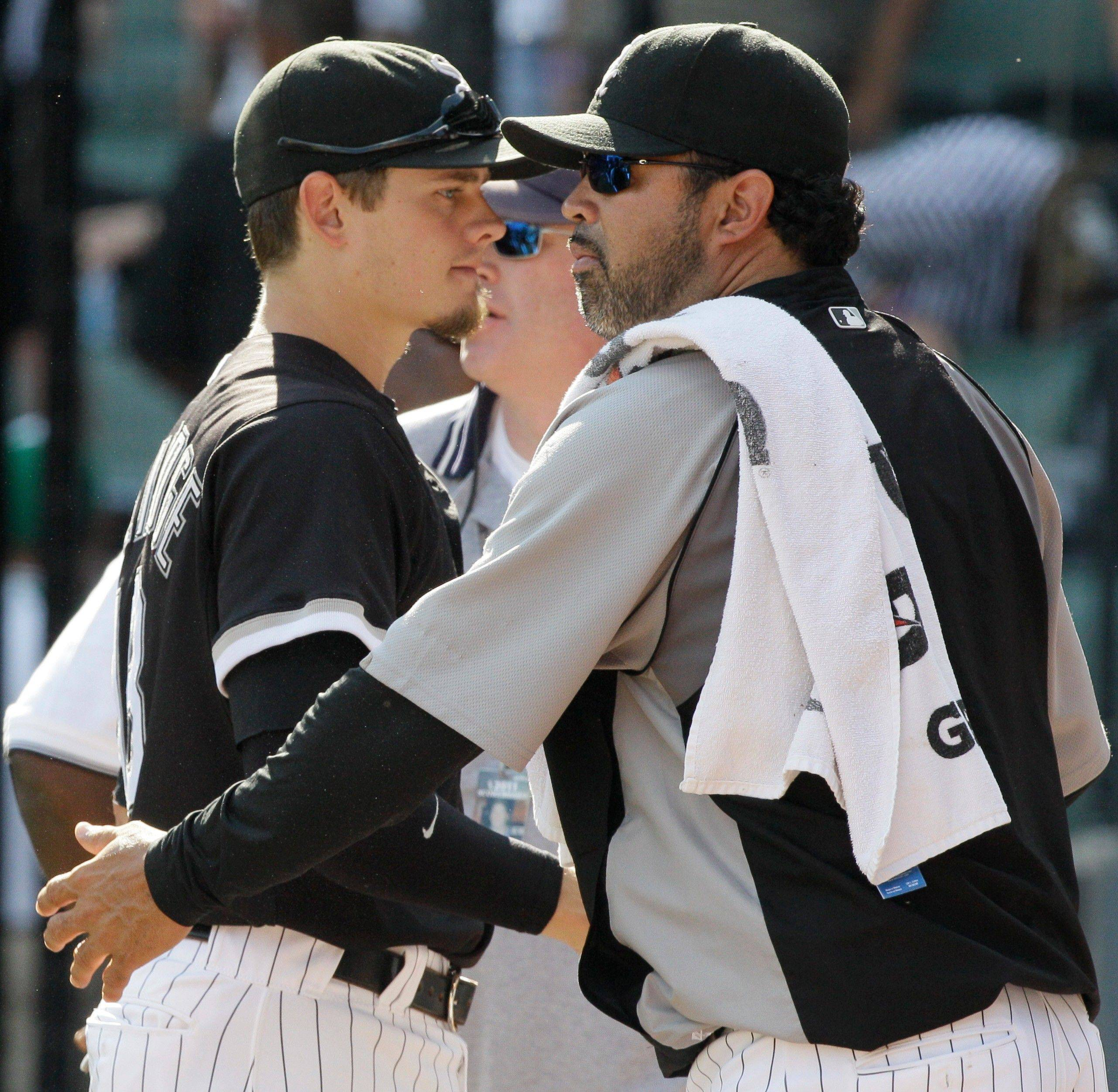 Manager Ozzie Guillen, right, celebrates with Brent Lillibridge after the White Sox� rout of the Rangers on Sunday. Lillibridge got the offense rolling with a 2-run homer in the third inning.