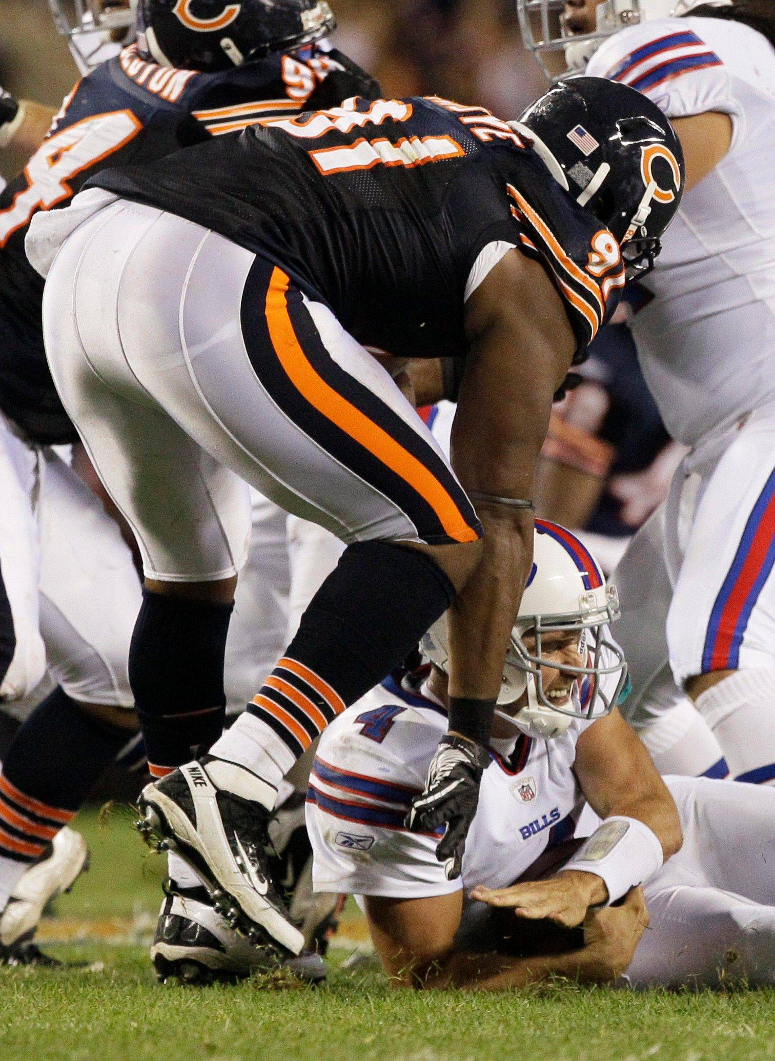 Bears defensive tackle Amobi Okoye sacks Bills quarterback Tyler Thigpen in the preseason opener.