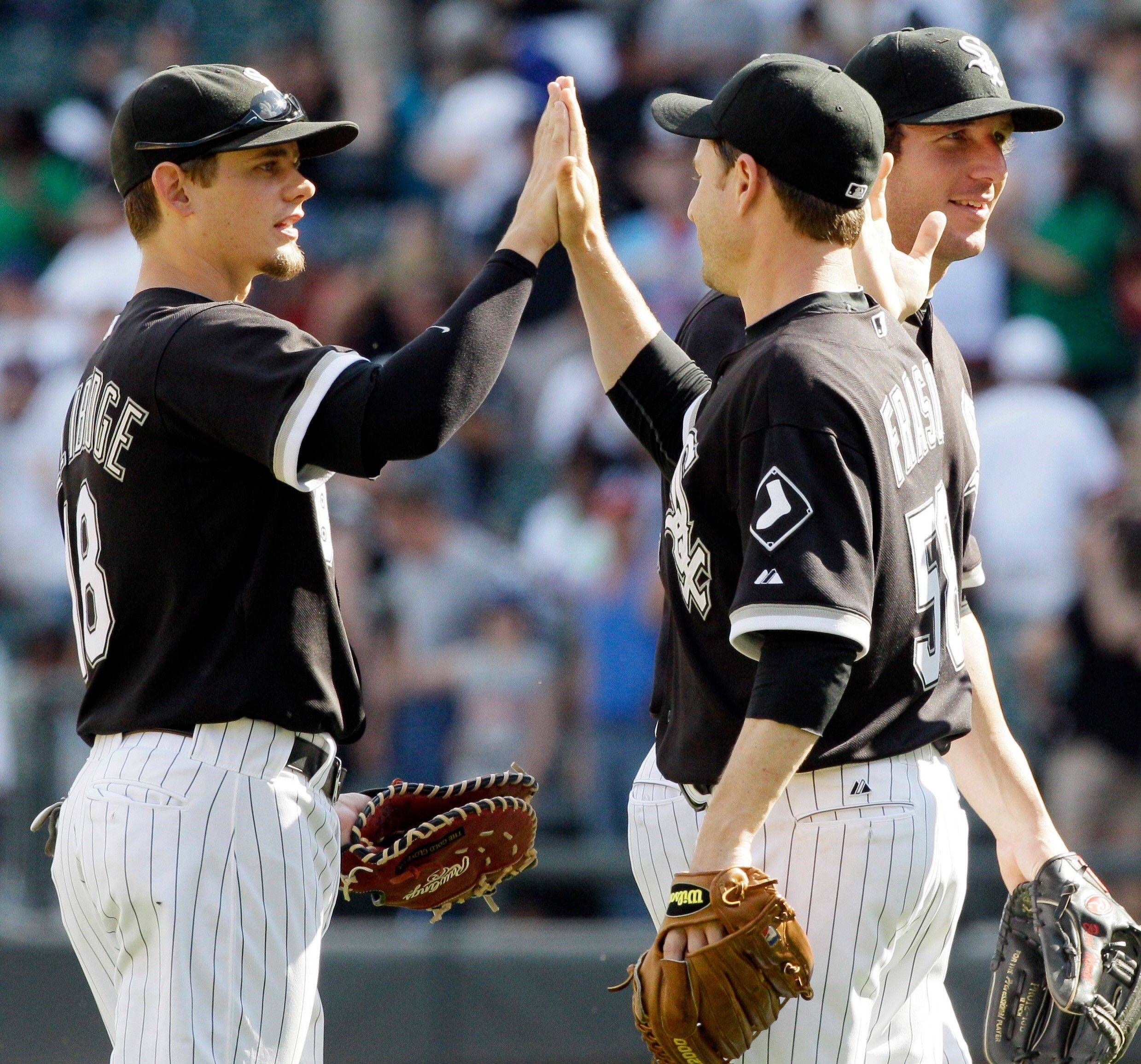 Brent Lillibridge, left, celebrates with closer Jason Frasor, center, and Brent Morel after the White Sox defeated the Texas Rangers 10-0 Sunday at U.S. Cellular Field.