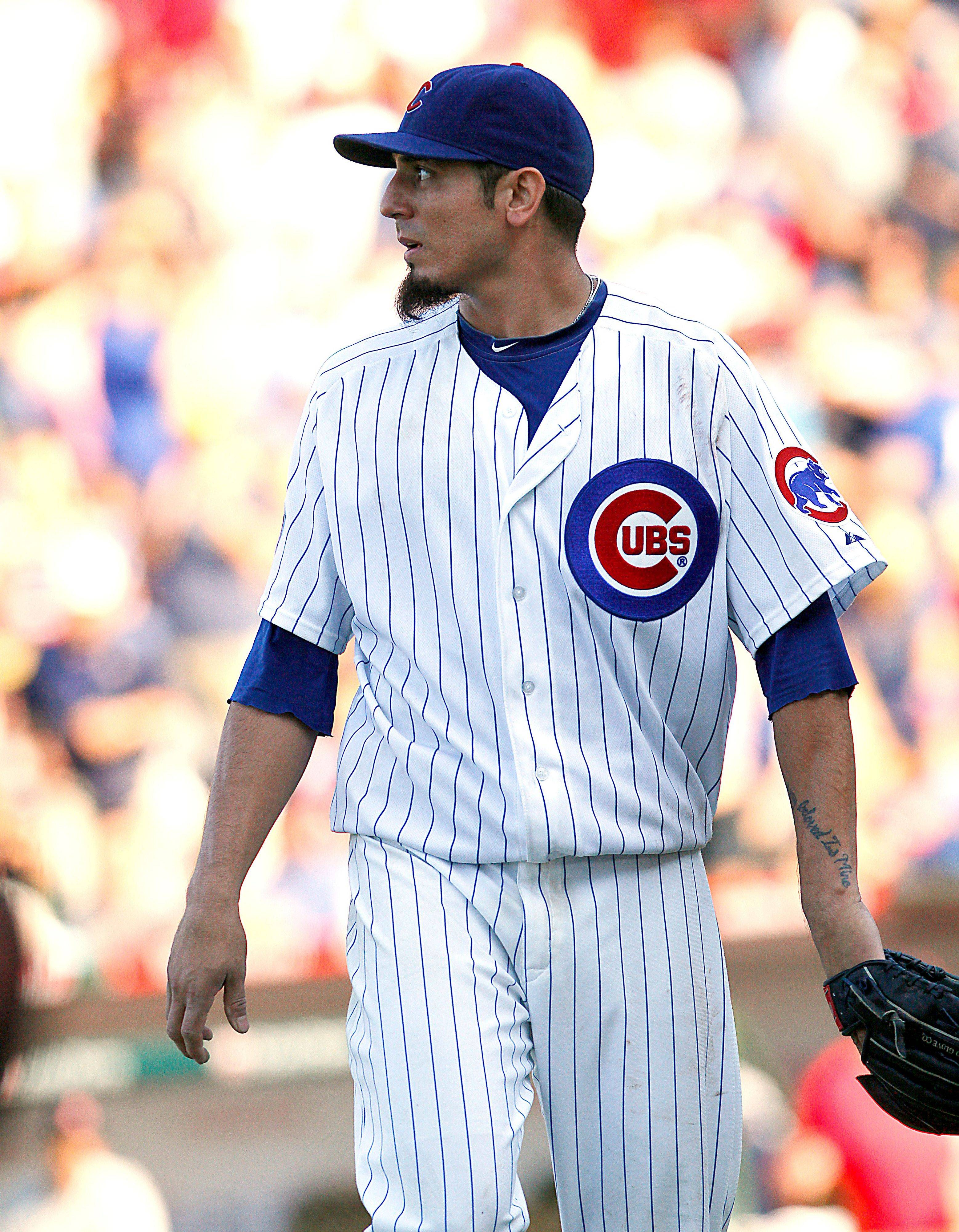 Chicago Cubs starting pitcher Matt Garza looks at the scoreboard after pitching out of a jam in the seventh inning Saturday against the St. Louis Cardinals in Chicago.