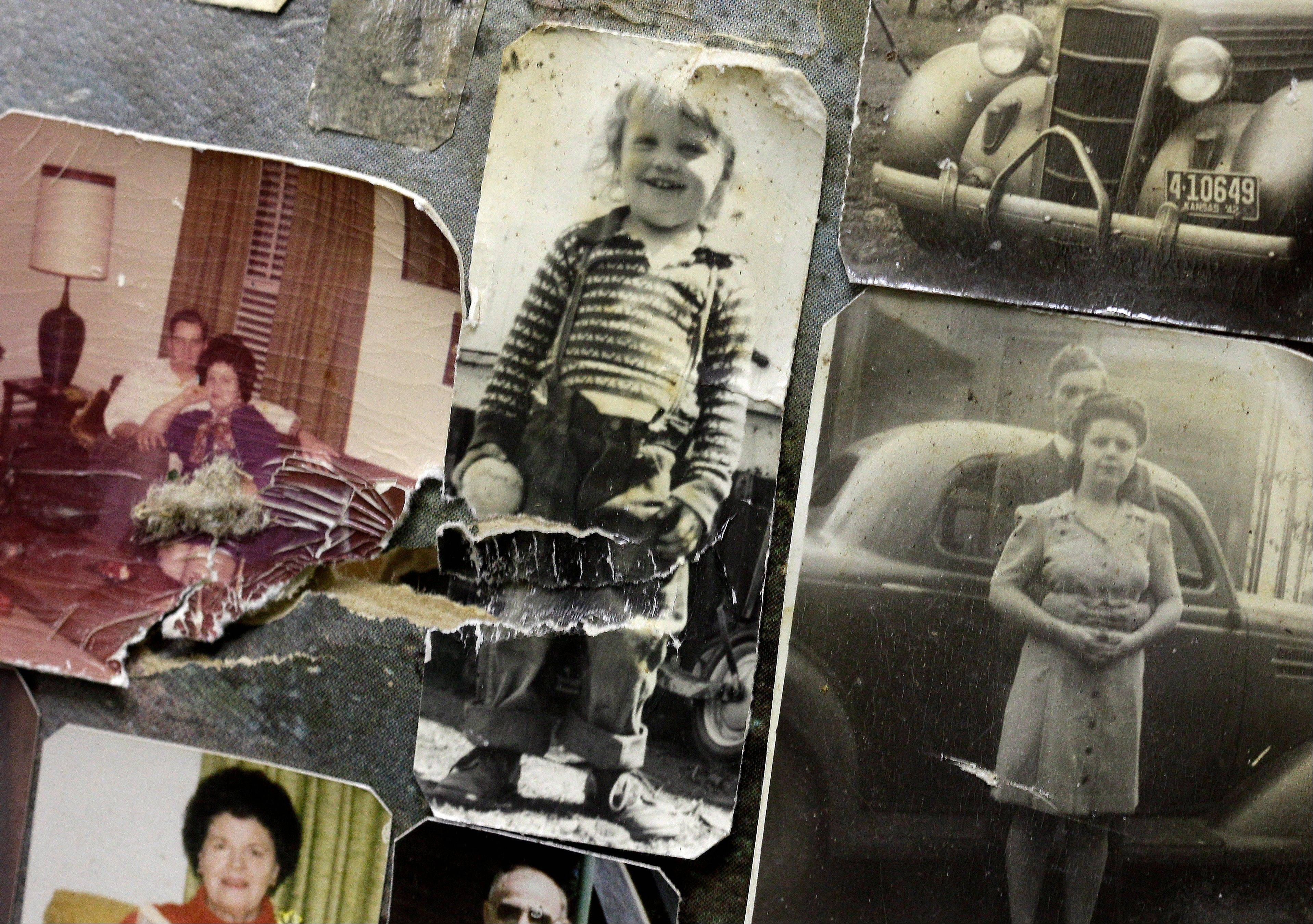 Damaged photos are seen at the First Baptist Church in Carthage, Mo. where volunteers are cleaning and sorting photos and other personal documents found among rubble after a powerful EF-5 tornado destroyed a large swath of nearby Joplin, Mo. on May 22, 2011. The church has taken on the task of preserving thousands of lost photos and reuniting them with their owners.