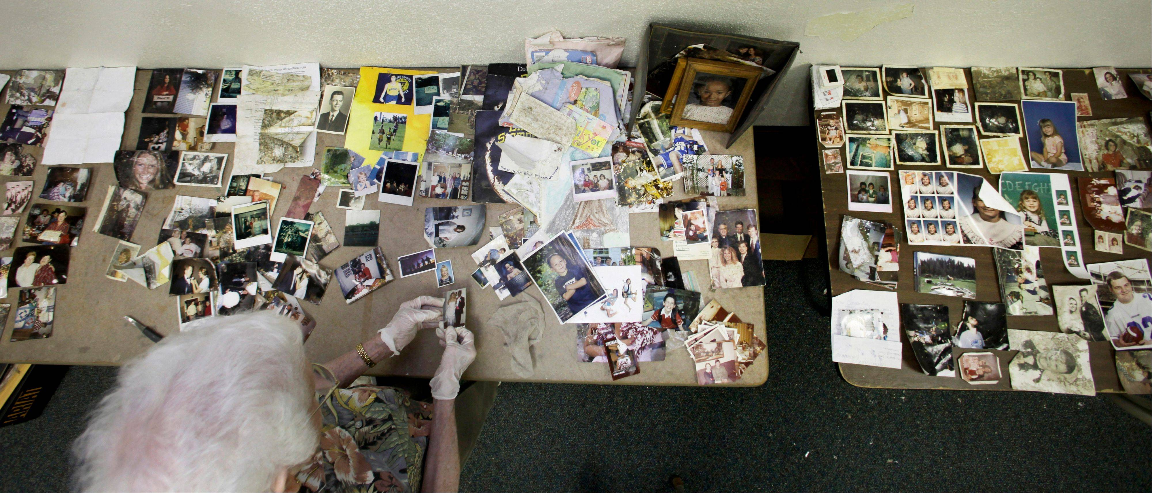 Vivian Love, a volunteer at the First Baptist Church in Carthage, Mo., cleans and sorts photos and other personal documents found among rubble after a powerful EF-5 tornado destroyed a large swath of nearby Joplin, Mo. on May 22, 2011. The church has taken on the task of preserving thousands of lost photos and reuniting them with their owners.