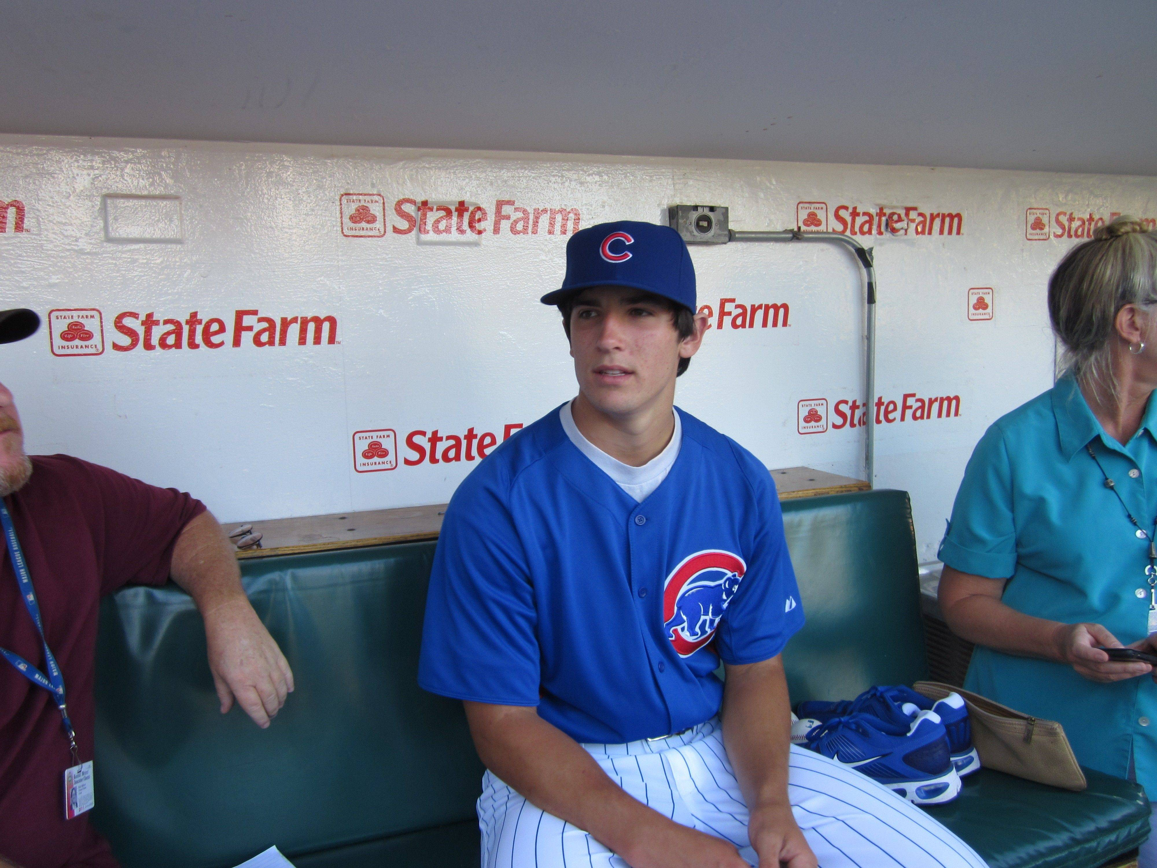 Recently signed Cubs draft pick Dillon Maples sits in the Cubs' dugout before Sunday night's game.