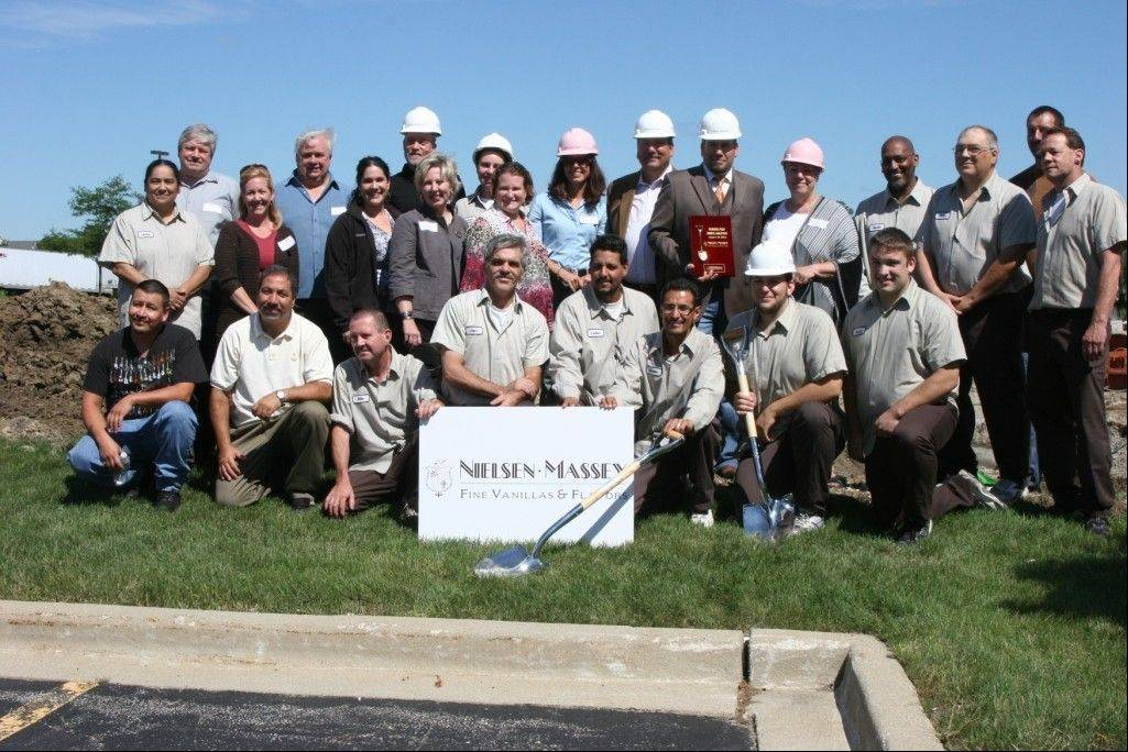 All the Nielsen-Massey employees participate in the groundbreaking for the expansion at the Waukegan headquarters.