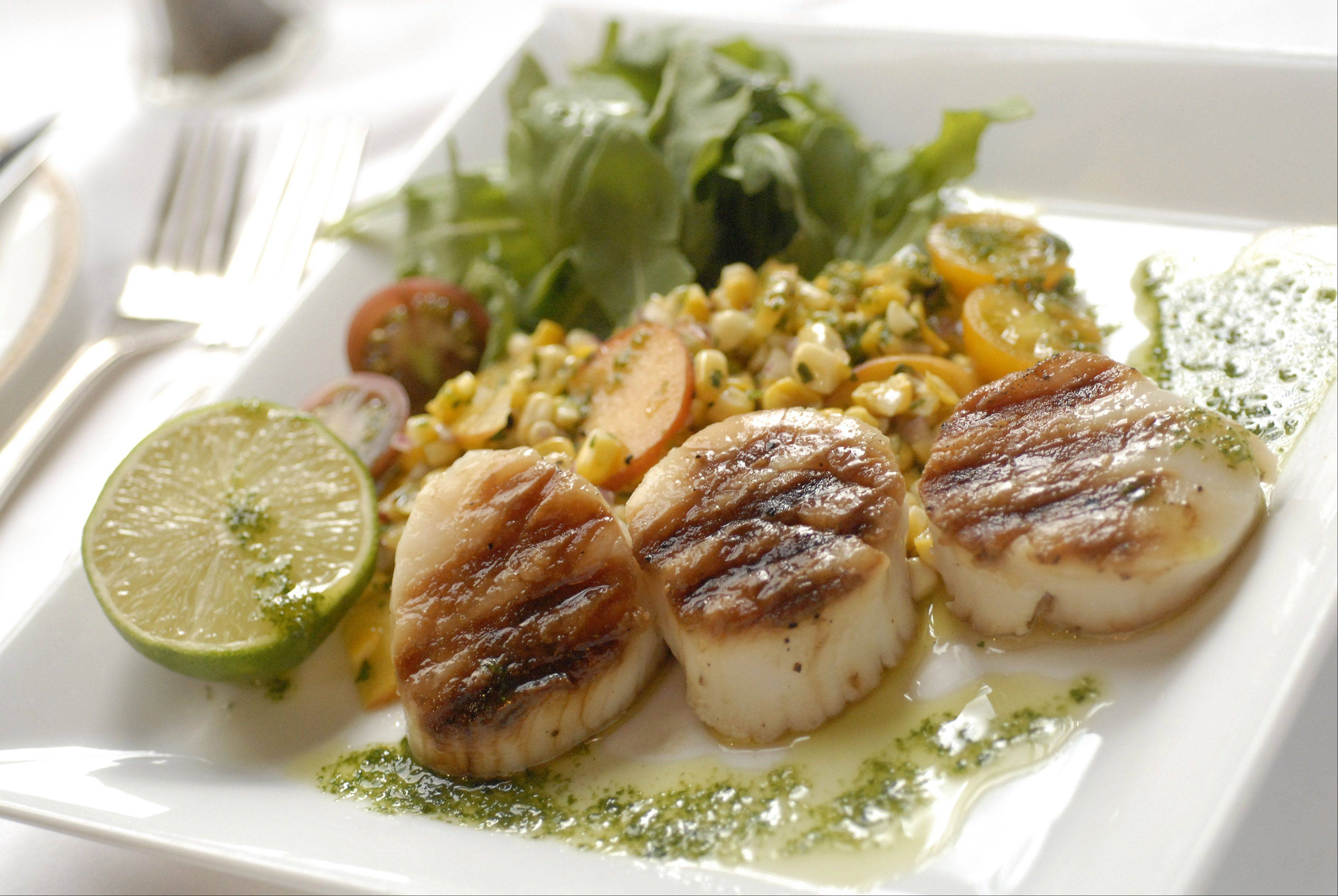 Chef Michael Garbin�s Sea Scallops with Roasted Corn and Peach Salad with Arugula and Cilantro Oil pleases diners at the Union League of Chicago. He said it takes about 45 minutes to prepare at home.