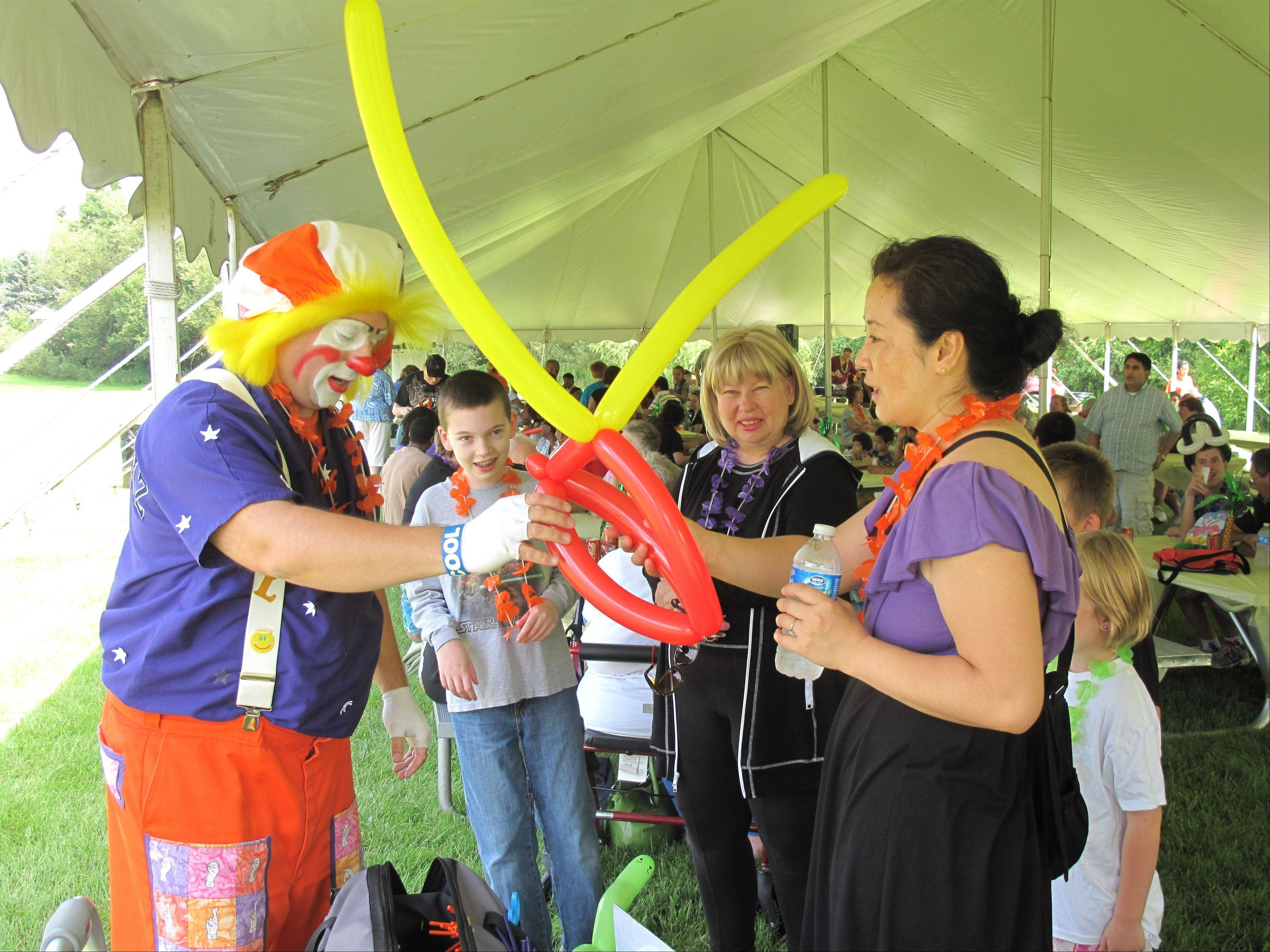 A clown entertains guests Saturday, Aug. 6, at the Schaumburg Township Disability Services Luau Picnic.