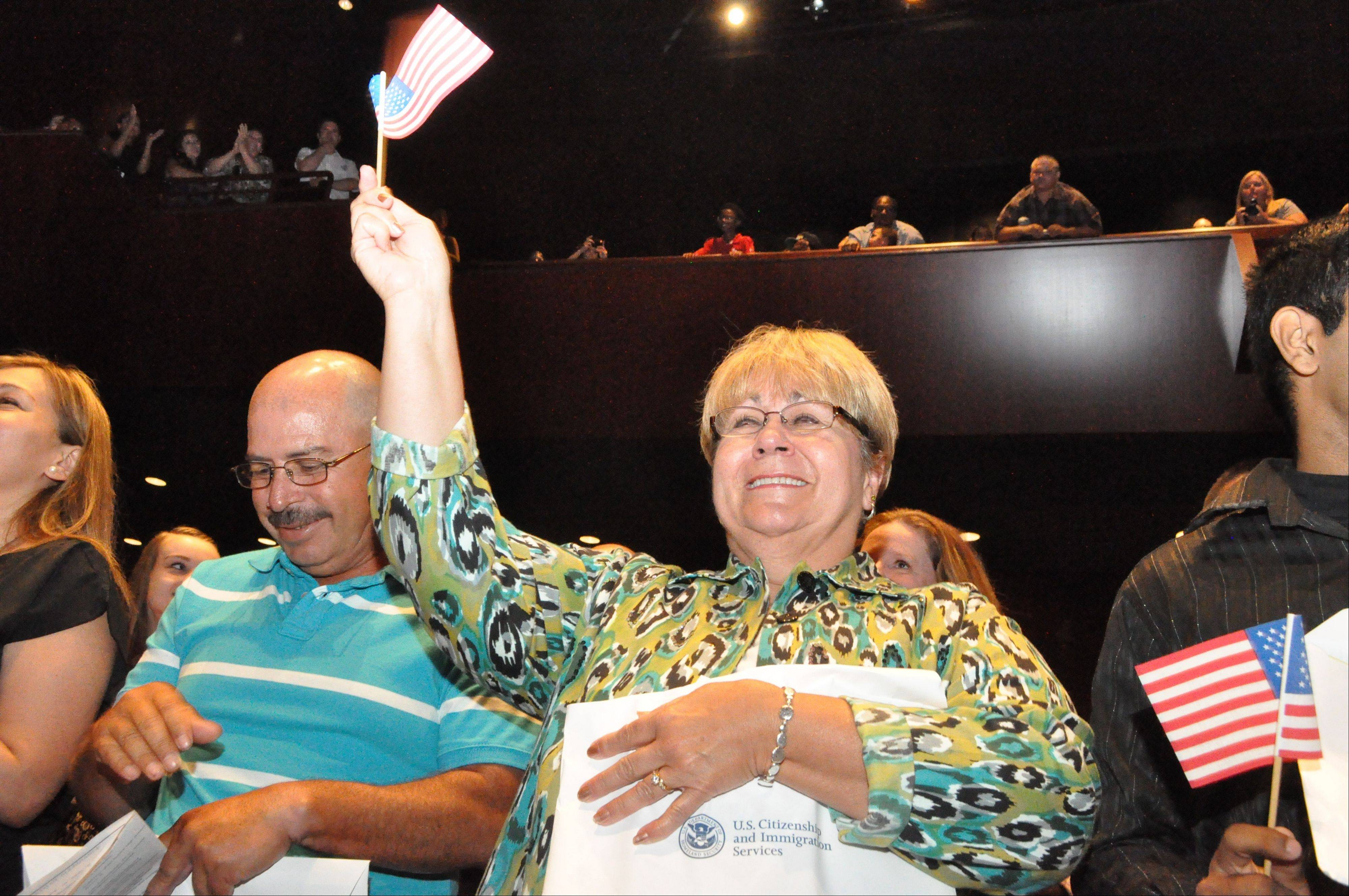 Alla Andrej of Freeport, center, was among about150 local residents from 42 countries who became naturalized citizens in a second annual ceremony at Aurora University's Crimi Auditorium on Aug. 5. Andrej, 64, is a native of Germany. Other new citizens hailed form Afghanistan to Zimbabwe.